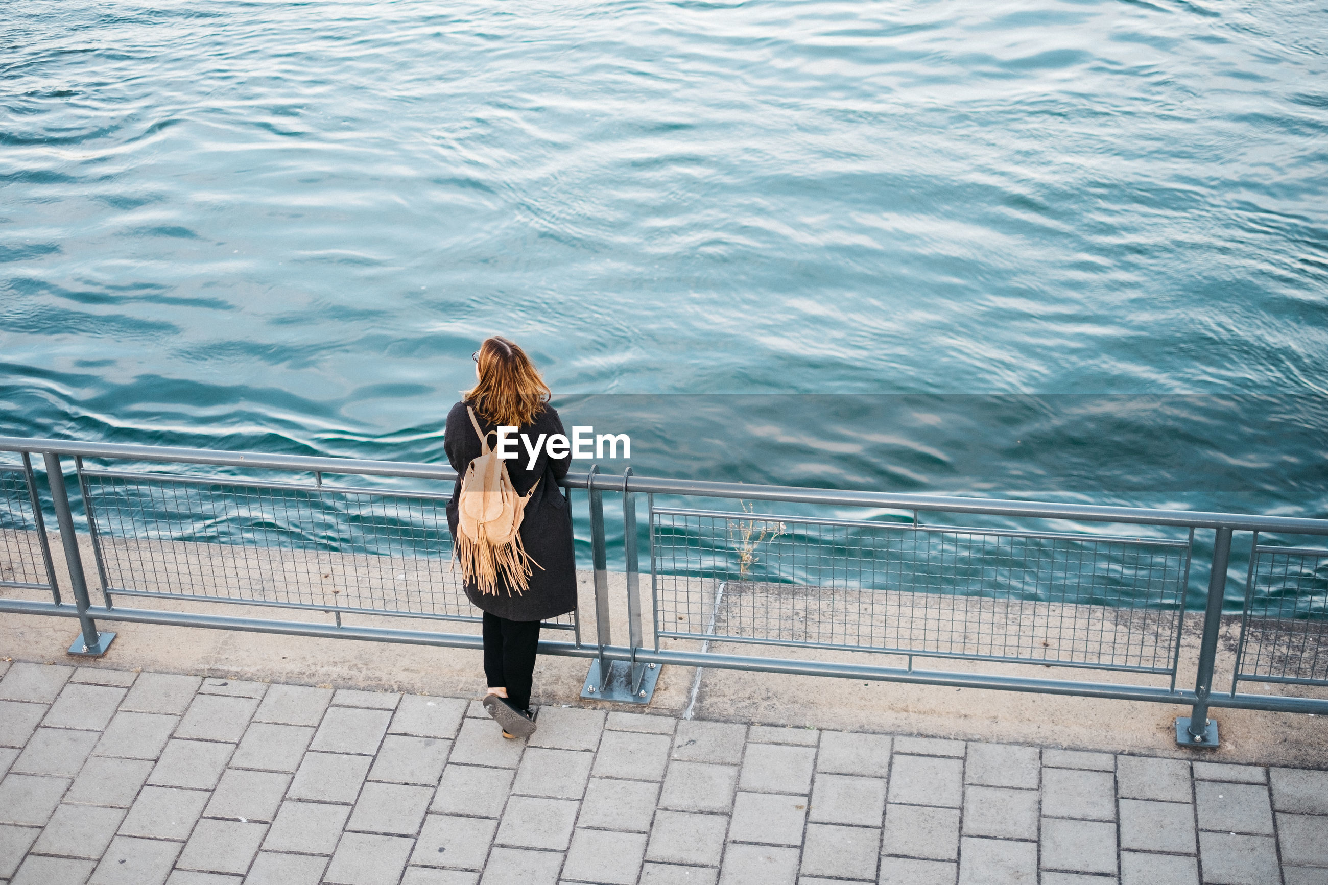 High angle view of woman standing at promenade