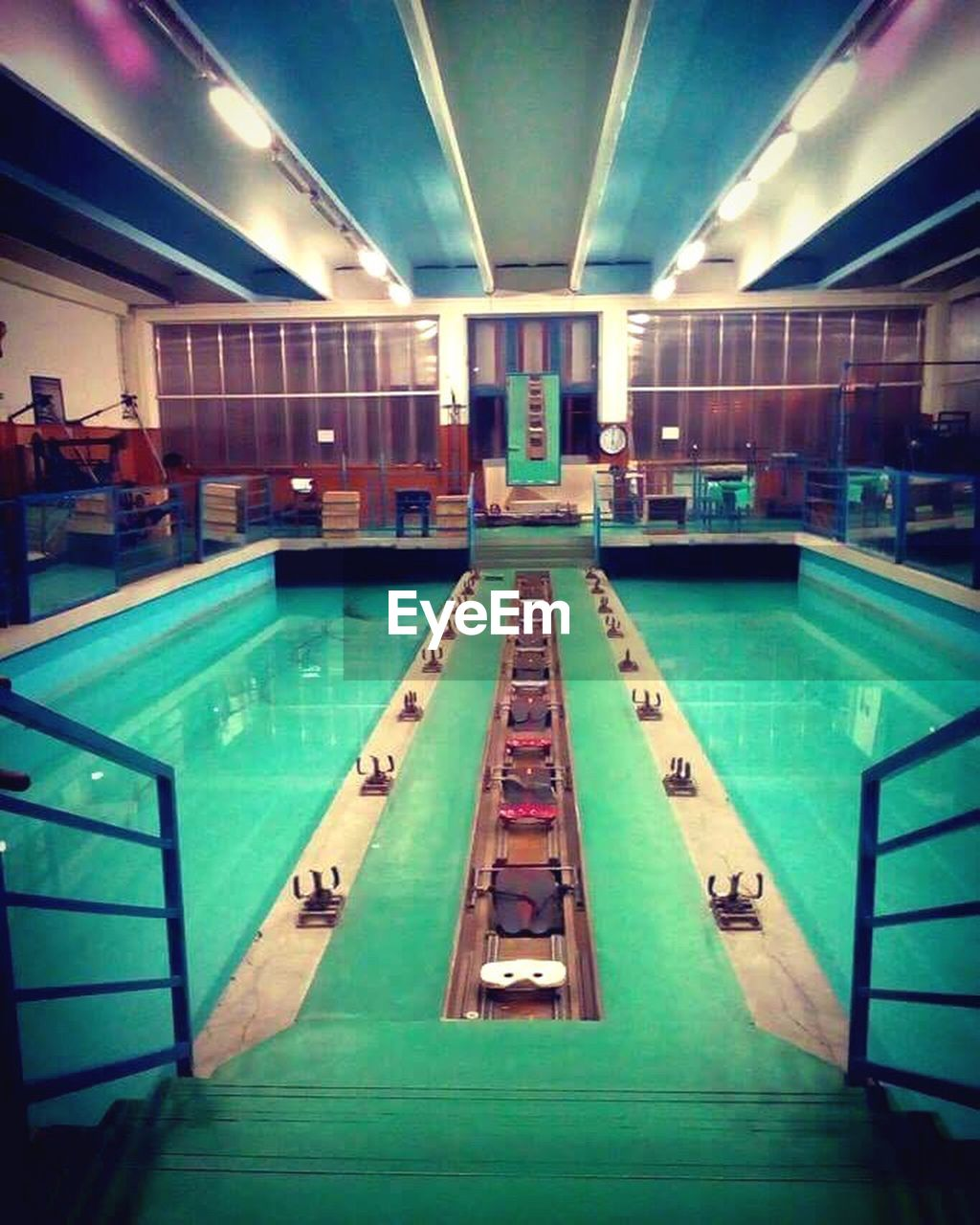 indoors, swimming pool, illuminated, pool table, water, architecture, modern, pool - cue sport, day, pool ball, no people, snooker and pool, pool cue