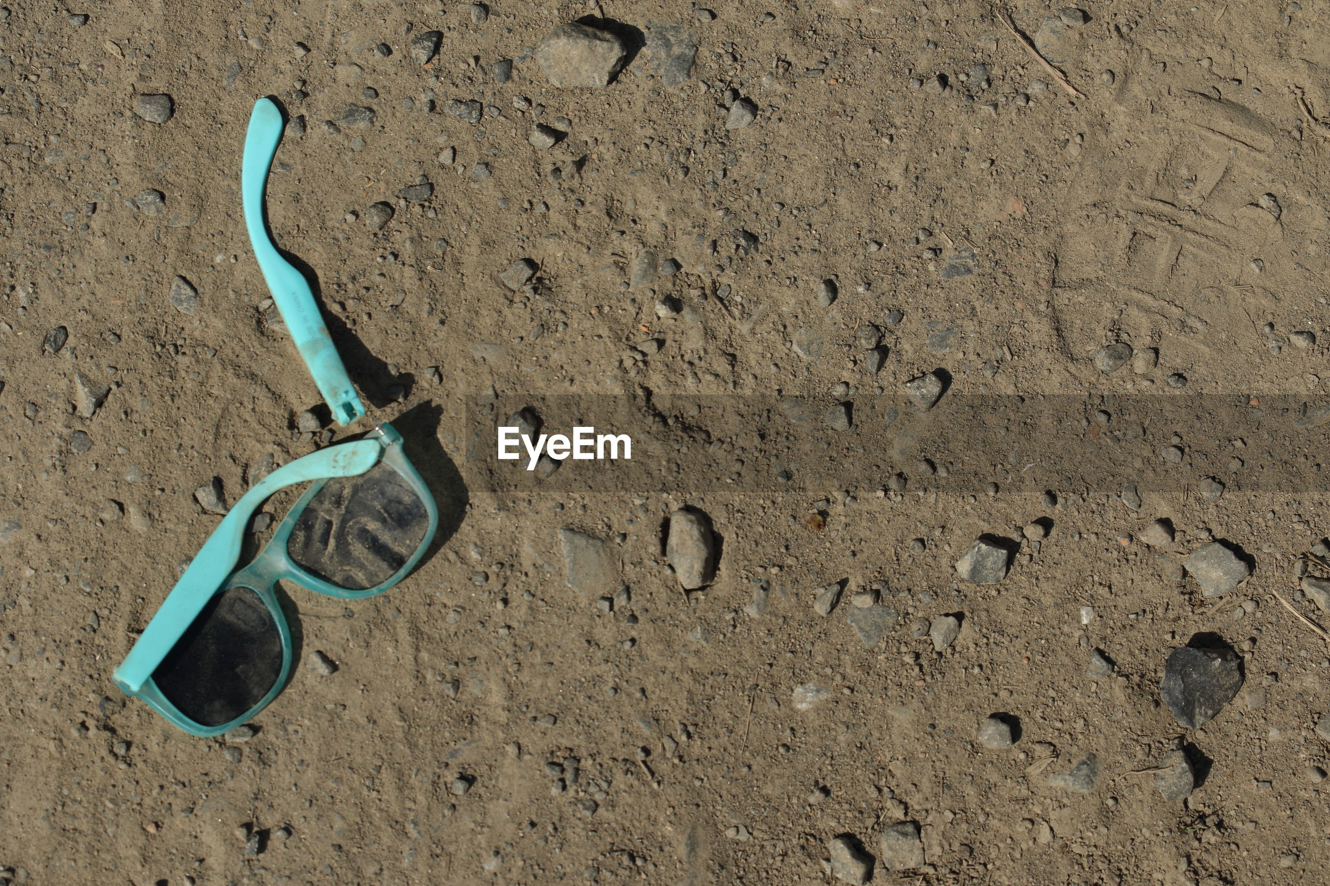 High angle view of broken sunglasses