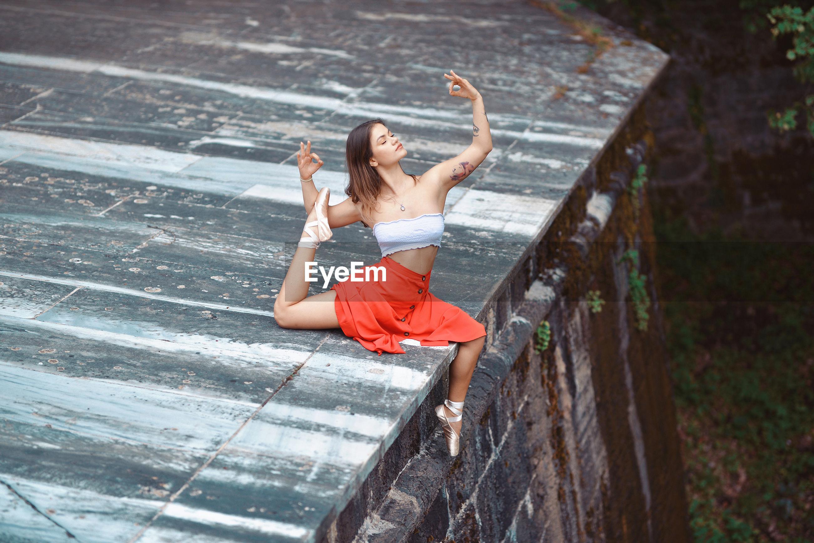 Young woman dancing outdoors