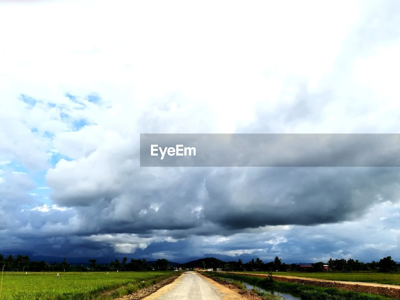 landscape, cloud - sky, field, nature, sky, scenics, road, day, outdoors, beauty in nature, tranquility, transportation, rural scene, the way forward, no people, tree, grass