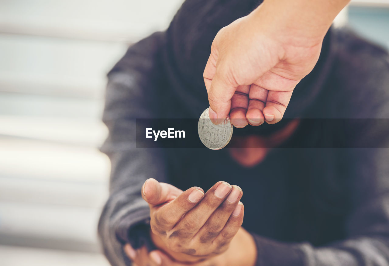 hand, human hand, coin, holding, finance, currency, one person, real people, savings, wealth, business, men, midsection, focus on foreground, human body part, investment, males, close-up, selective focus, economy, finger