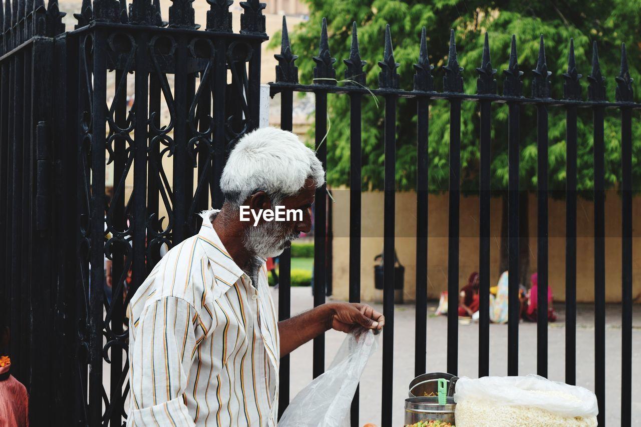 Man selling food outdoors