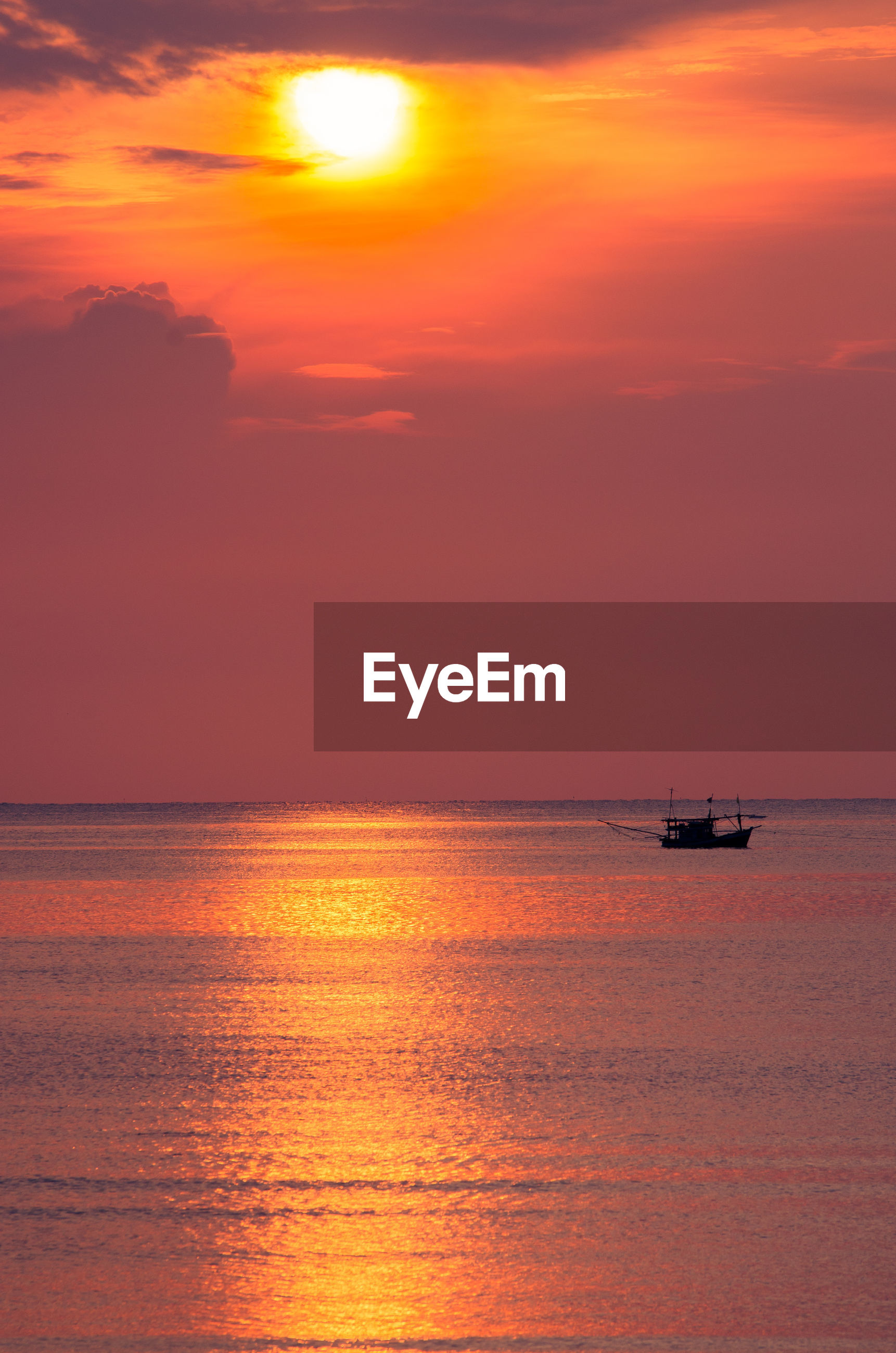 Scenic view of seashore at sunset