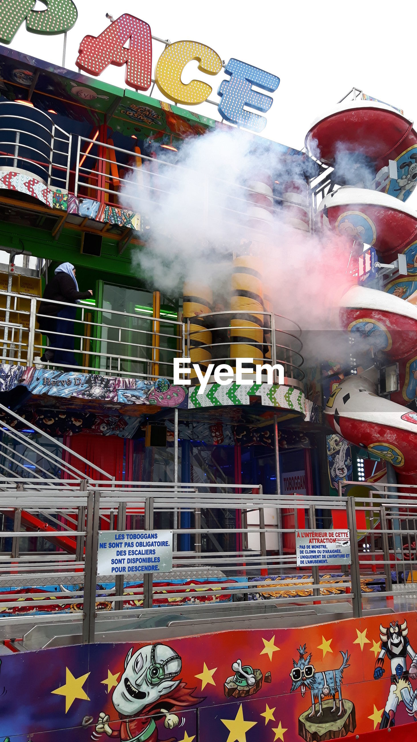 multi colored, built structure, arts culture and entertainment, smoke - physical structure, art, art and craft, architecture, indoors, building exterior, creativity, smoke, retail, no people, day, city, large group of objects, amusement park