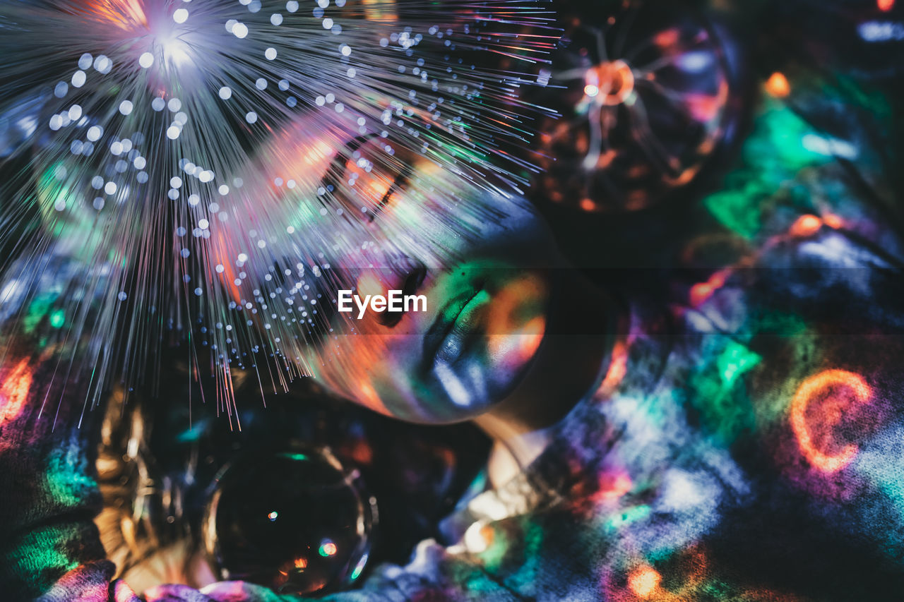 multi colored, illuminated, motion, night, no people, close-up, selective focus, light - natural phenomenon, lens flare, blurred motion, glowing, pattern, full frame, indoors, long exposure, sphere, backgrounds, decoration, arts culture and entertainment, abstract, nightlife, light