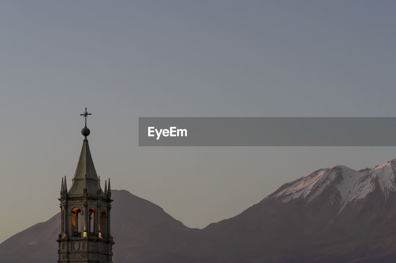 Basilica cathedral of arequipa against mountains at dusk