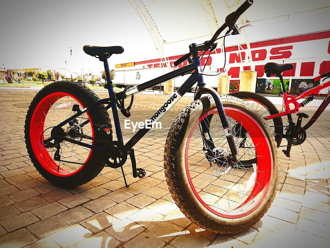 bicycle, transportation, mode of transport, land vehicle, wheel, stationary, tire, day, outdoors, no people, bicycle rack, spoke