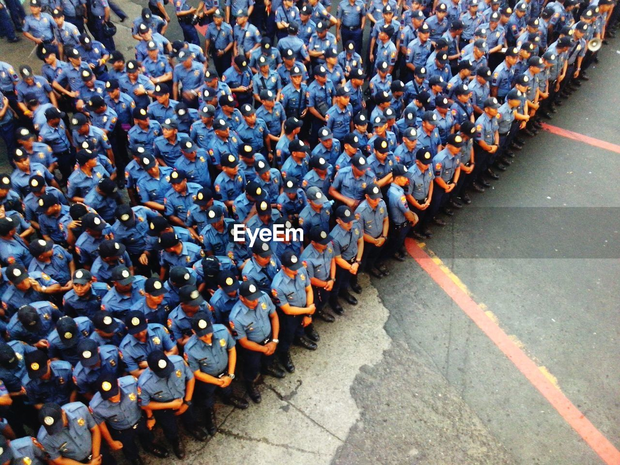High Angle View Of Police Officers Standing On Road