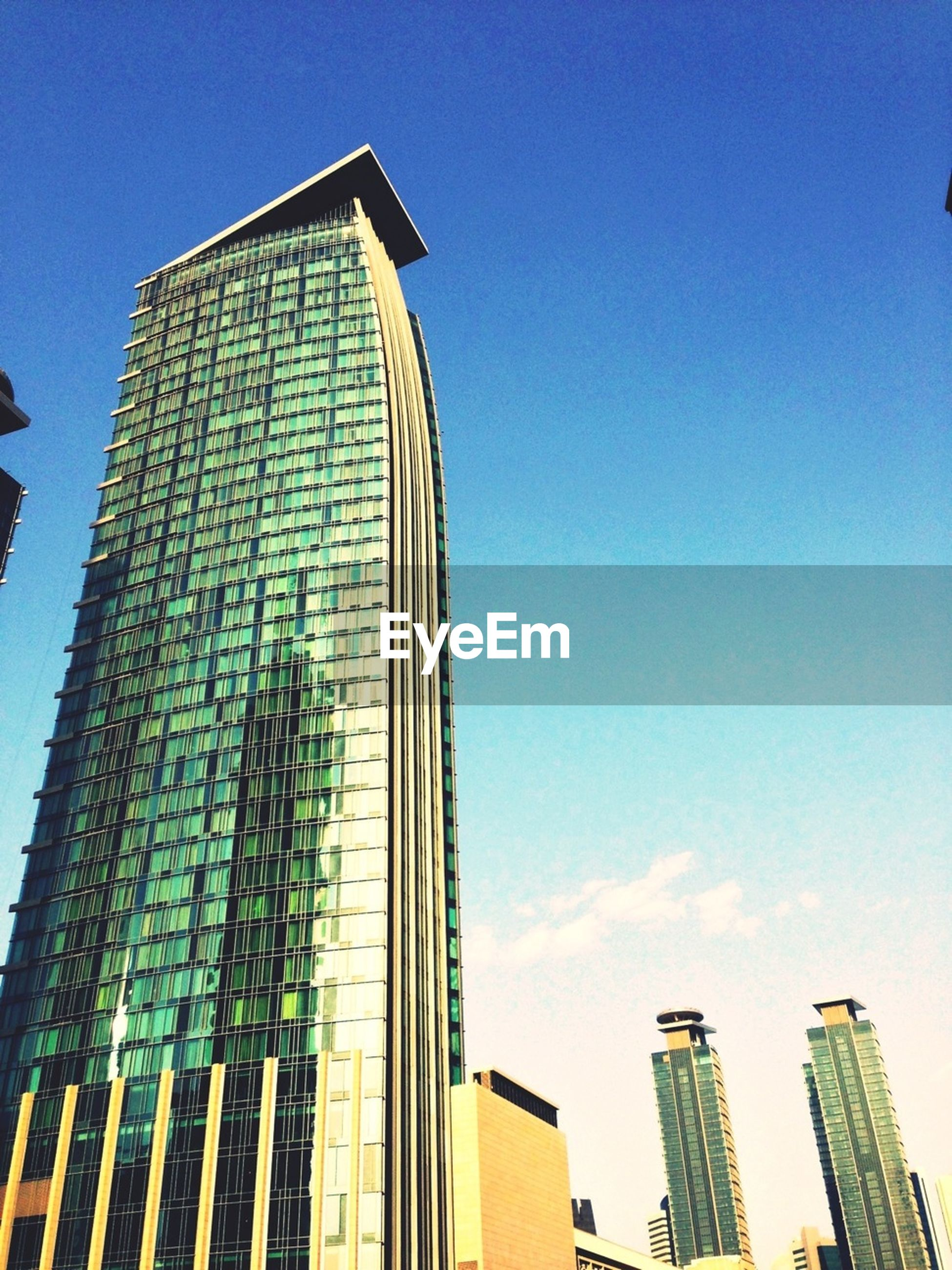 architecture, built structure, building exterior, low angle view, clear sky, modern, tall - high, blue, skyscraper, office building, city, tower, copy space, building, tall, sky, outdoors, day, travel destinations, no people