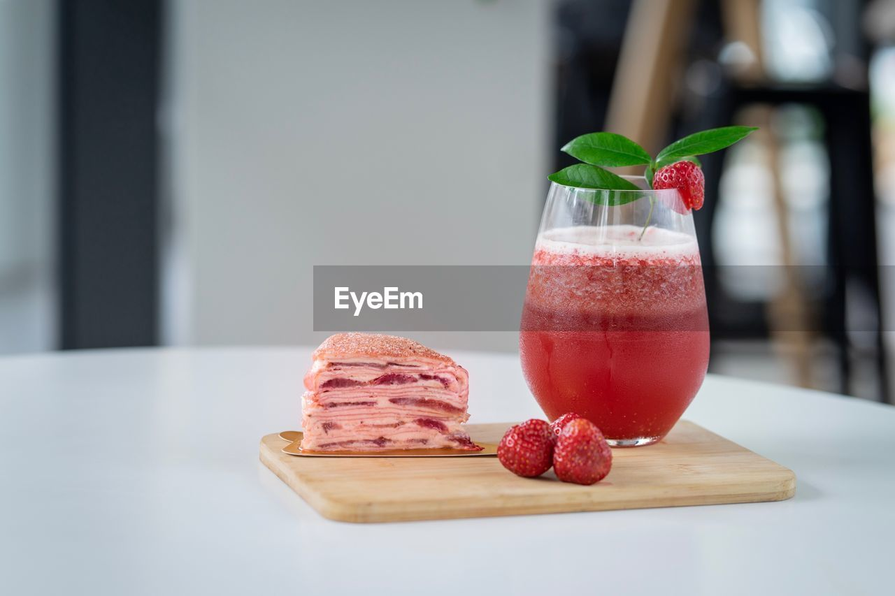 food and drink, freshness, fruit, berry fruit, food, table, strawberry, healthy eating, glass, still life, close-up, red, focus on foreground, drink, drinking glass, no people, refreshment, wellbeing, ready-to-eat, household equipment, mint leaf - culinary, herb, temptation, garnish