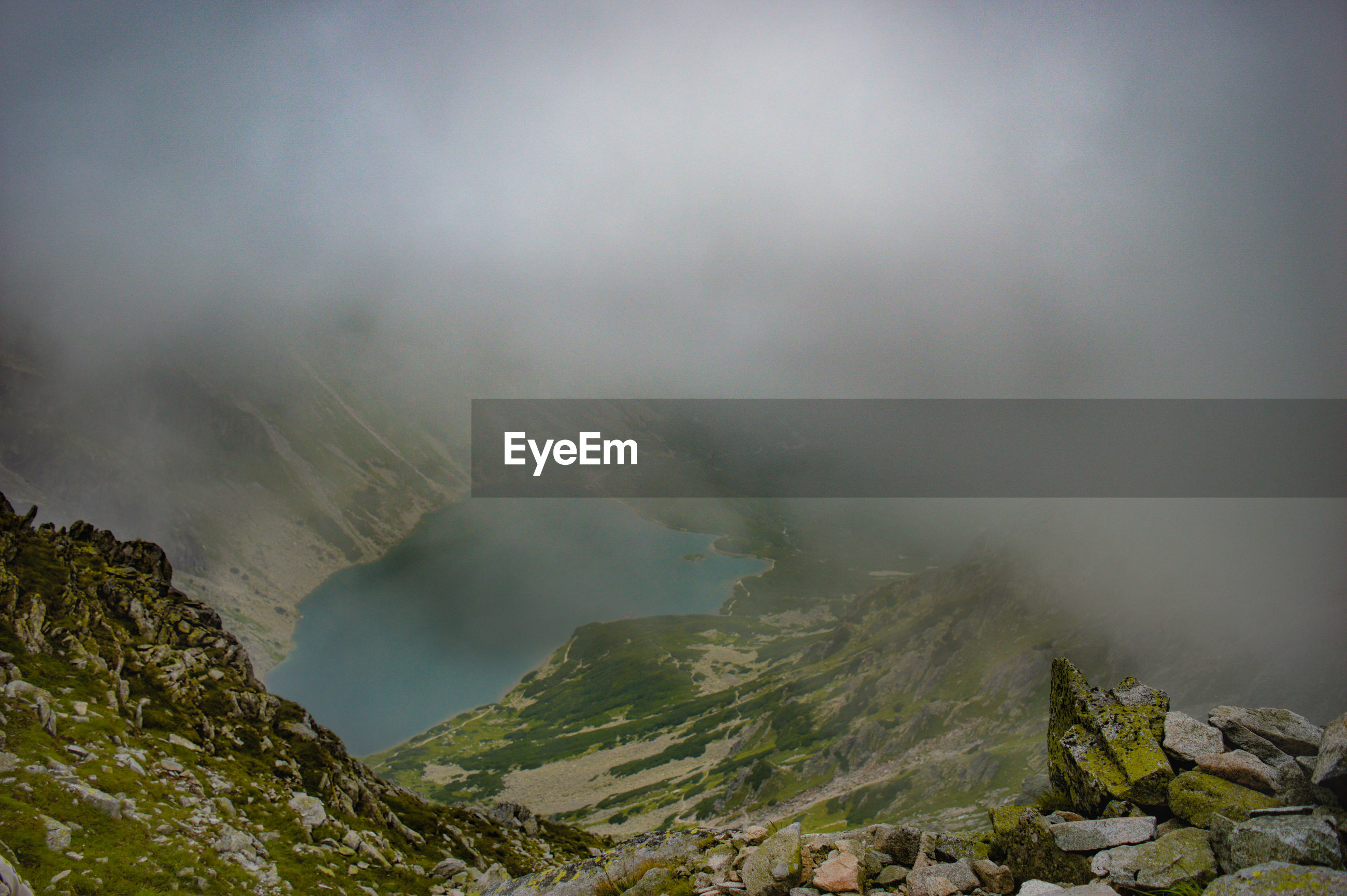 High angle view of lake during foggy weather