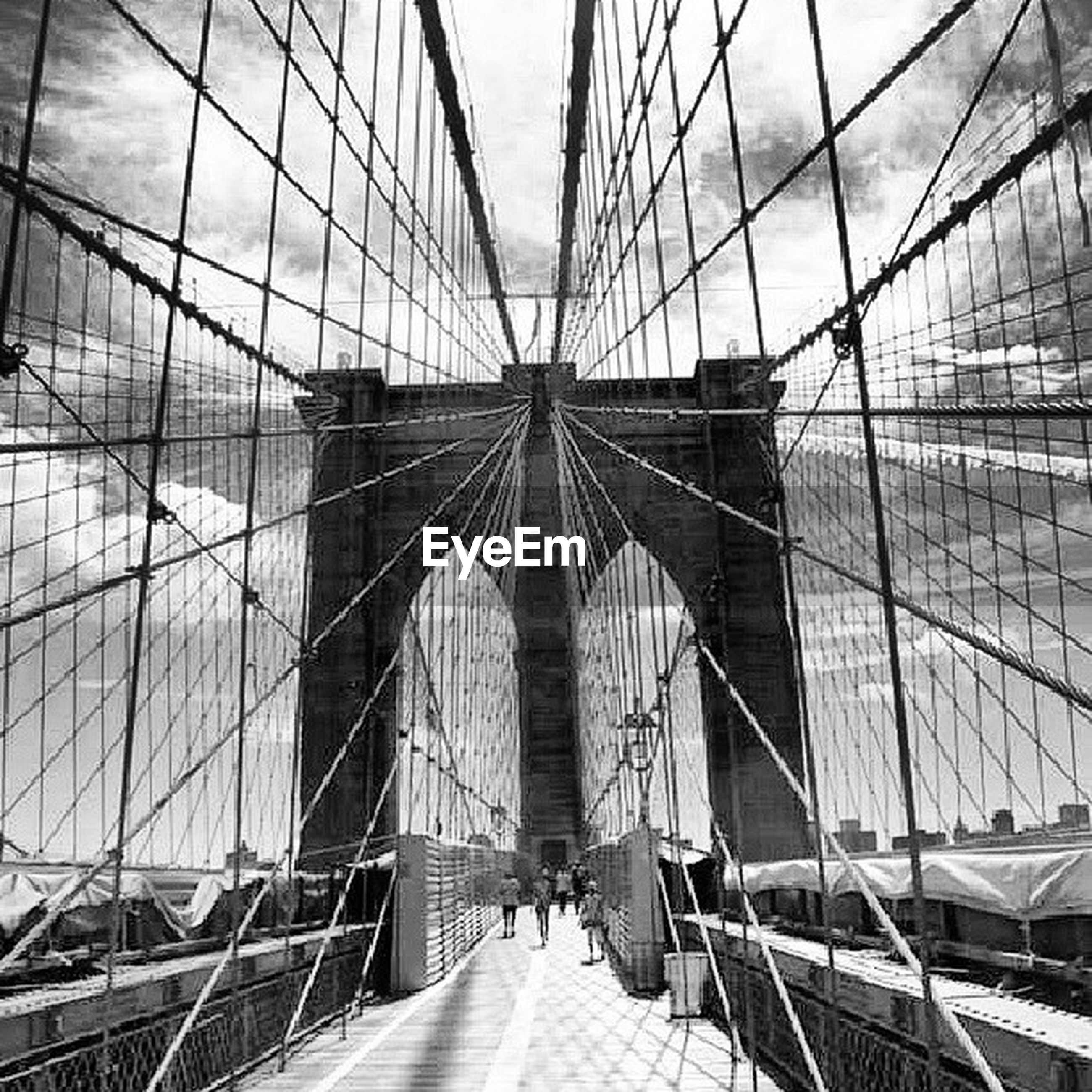 built structure, architecture, connection, bridge - man made structure, engineering, suspension bridge, transportation, the way forward, cable-stayed bridge, diminishing perspective, bridge, sky, famous place, travel destinations, international landmark, brooklyn bridge, vanishing point, travel, footbridge, modern