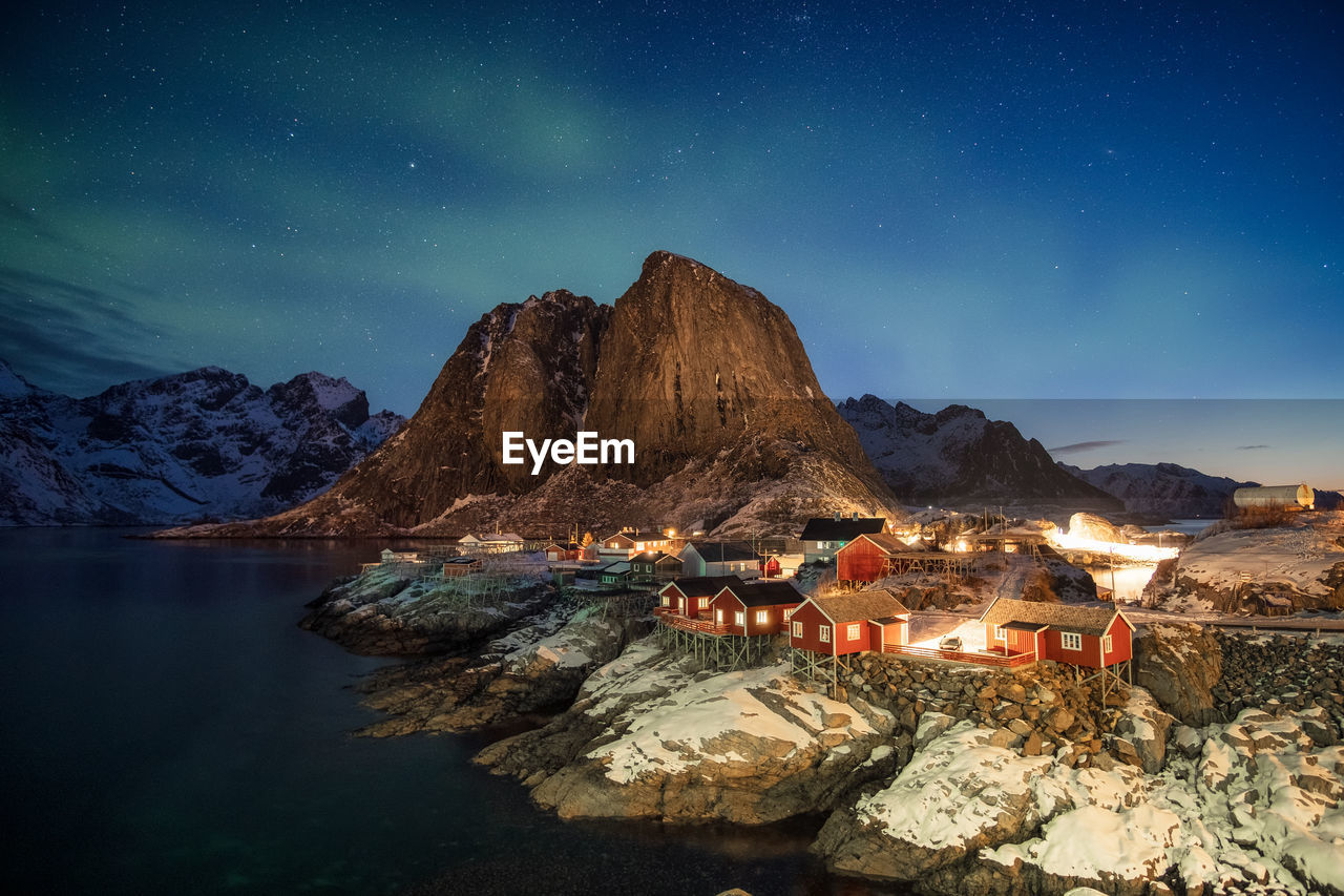 mountain, sky, scenics - nature, night, star - space, nature, beauty in nature, water, mountain range, lake, architecture, built structure, dusk, no people, non-urban scene, winter, illuminated, astronomy, tranquil scene