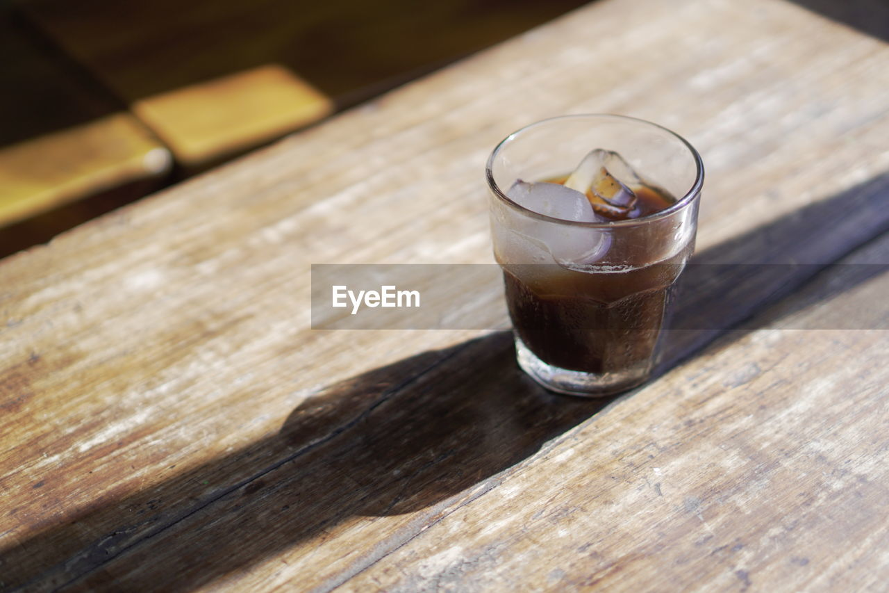 table, food and drink, wood - material, refreshment, glass, drink, drinking glass, still life, household equipment, freshness, indoors, coffee, coffee - drink, close-up, no people, food, high angle view, cold temperature, focus on foreground, frozen, non-alcoholic beverage