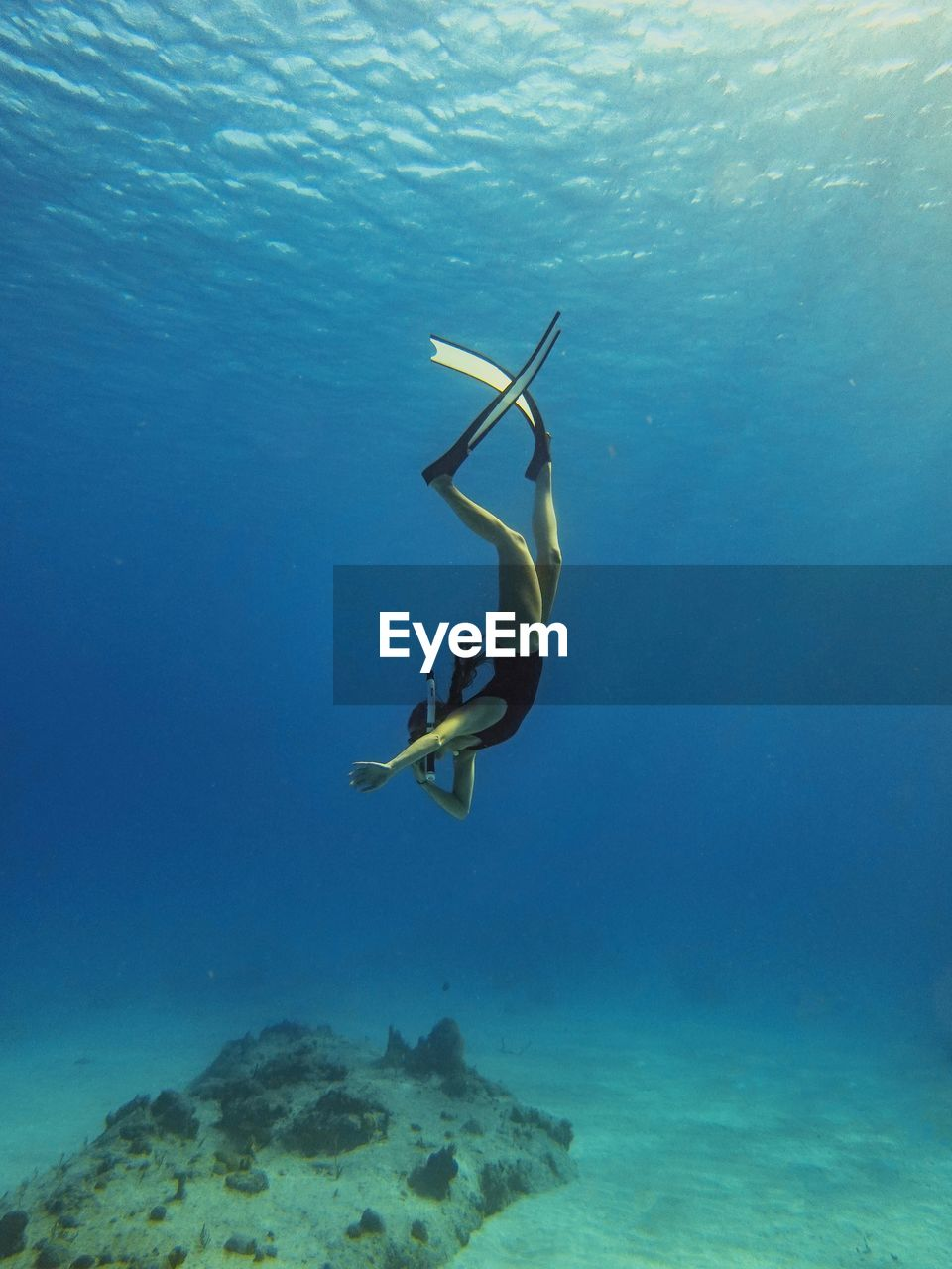 underwater, sea, water, undersea, swimming, adventure, one person, sport, real people, nature, leisure activity, aquatic sport, exploration, lifestyles, blue, diving equipment, day, full length, outdoors, snorkeling, marine, arms raised
