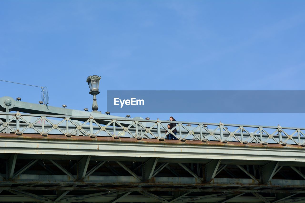 sky, built structure, architecture, low angle view, connection, bridge, blue, transportation, nature, bridge - man made structure, metal, day, rail transportation, no people, industry, outdoors, clear sky, building exterior, copy space