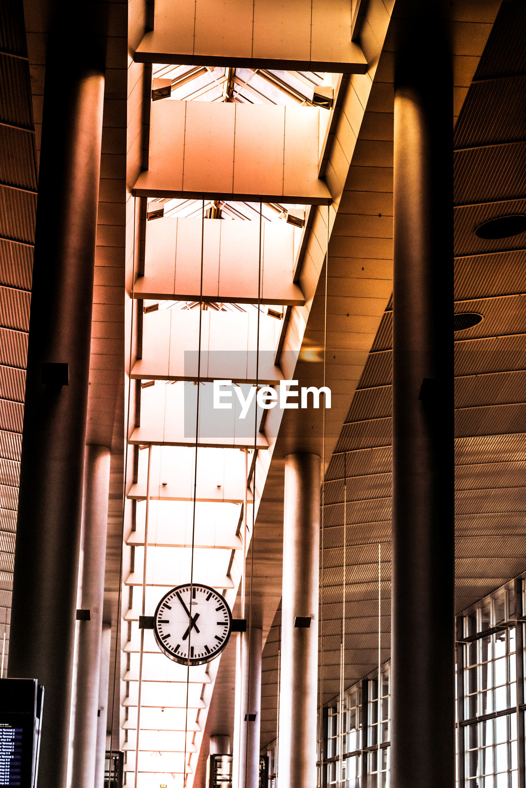 Low angle view of clock hanging to ceiling