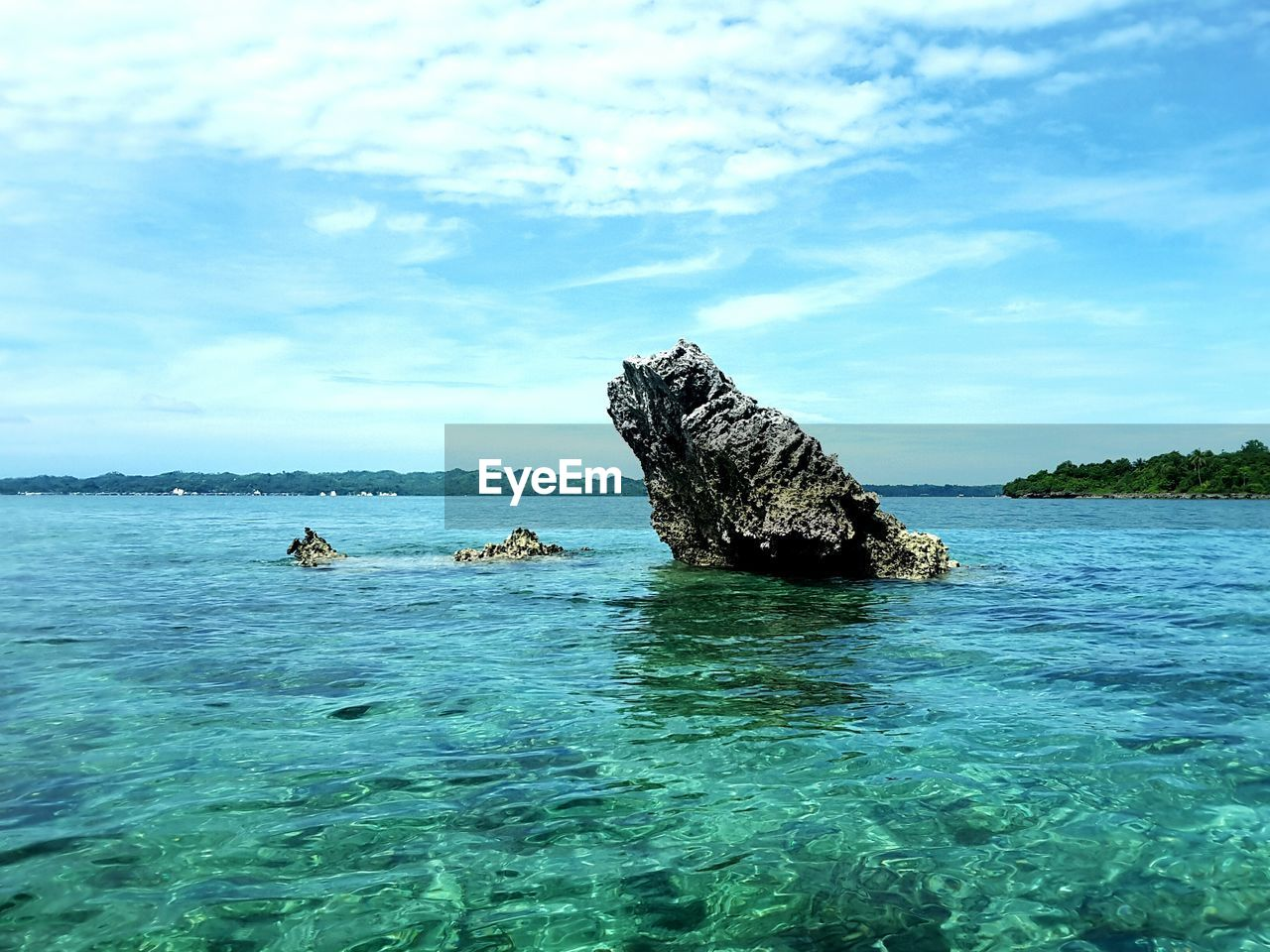 sea, rock - object, nature, water, beauty in nature, rock formation, tranquility, sky, scenics, day, tranquil scene, cloud - sky, waterfront, outdoors, no people, horizon over water