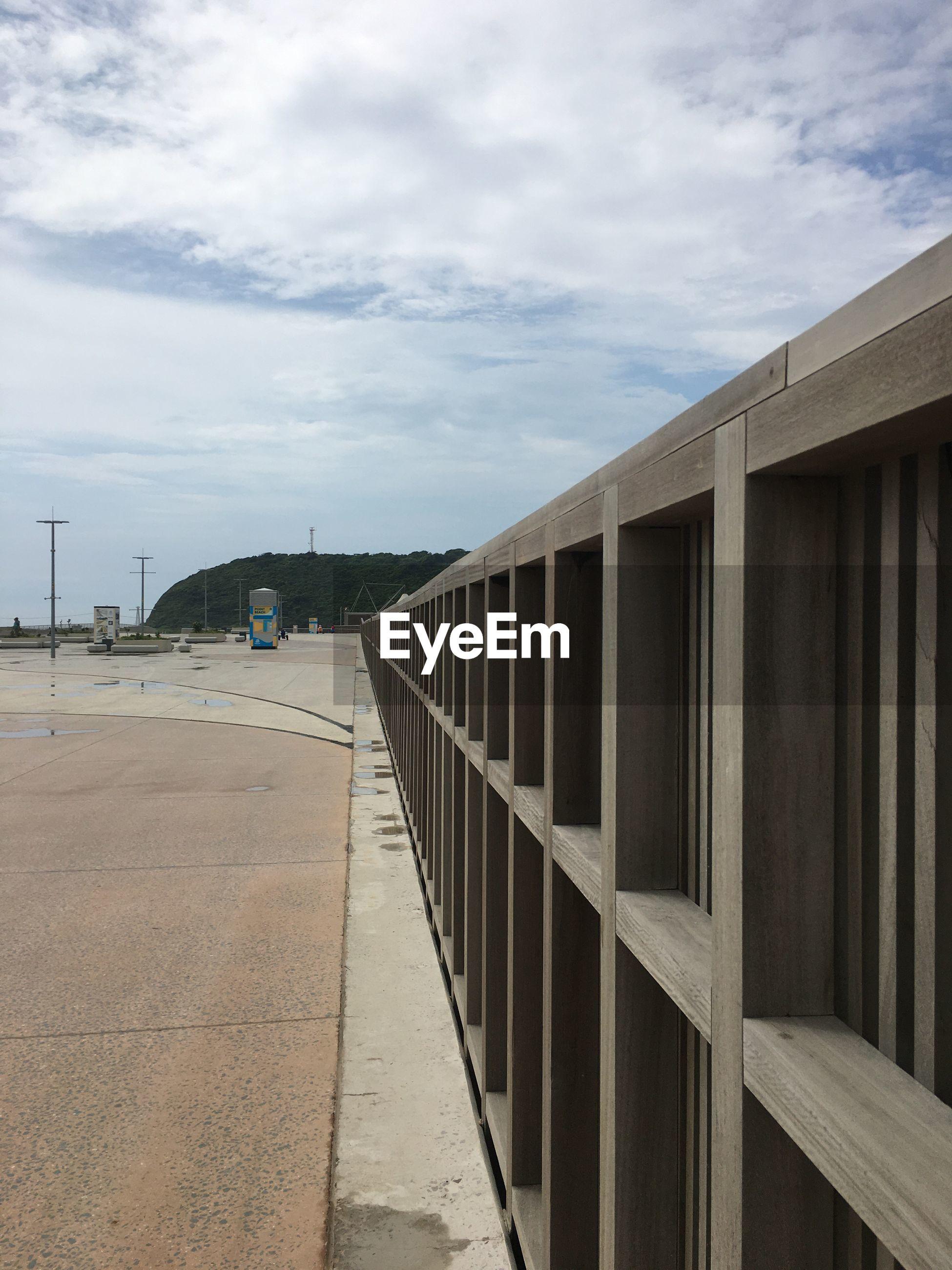 VIEW OF FOOTPATH AGAINST SKY