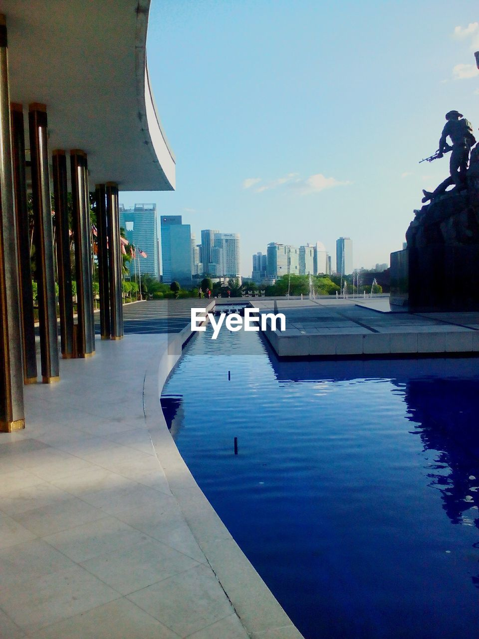 architecture, water, built structure, building exterior, swimming pool, sky, no people, outdoors, city, day, cityscape