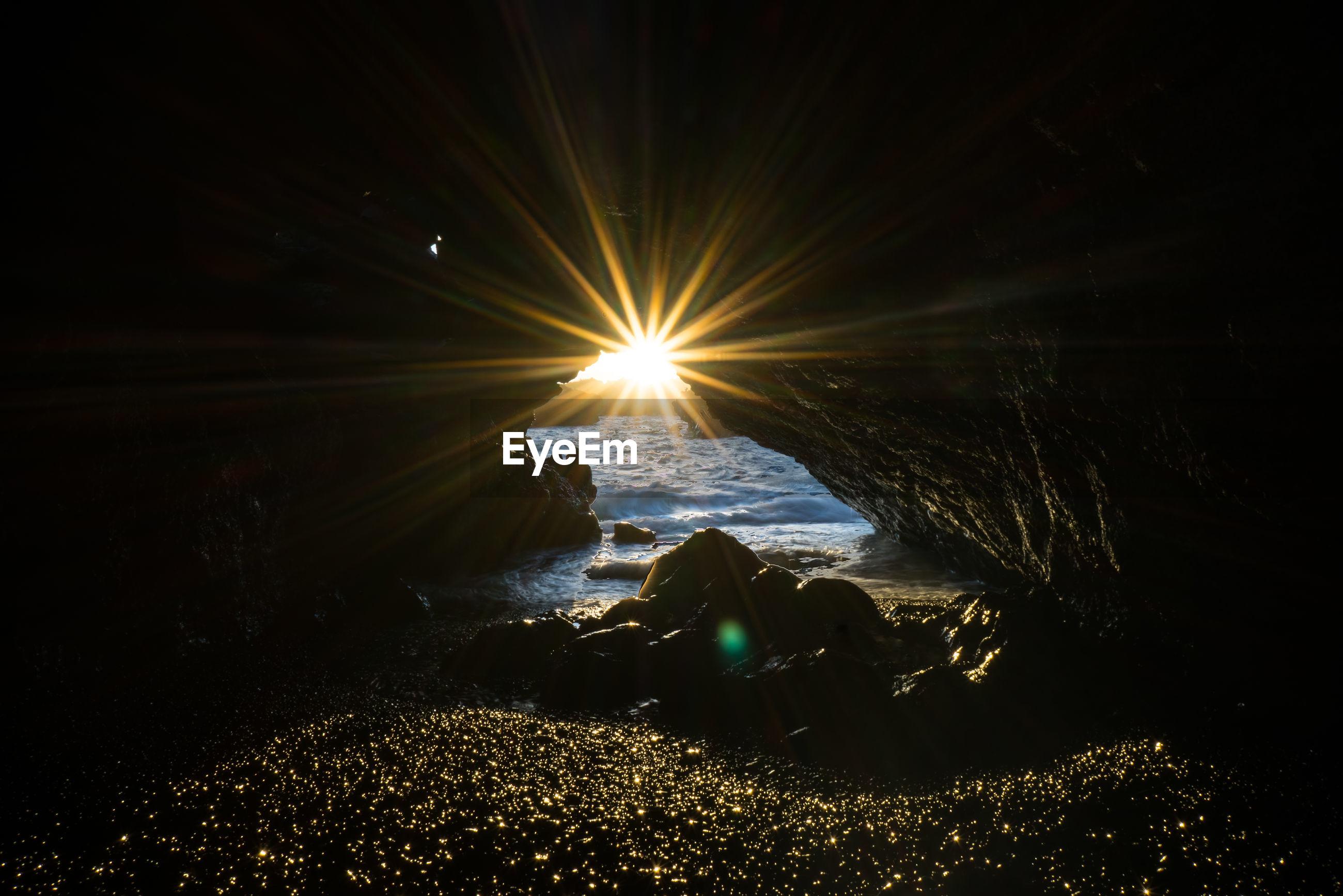 VIEW OF SEA AGAINST BRIGHT SUN