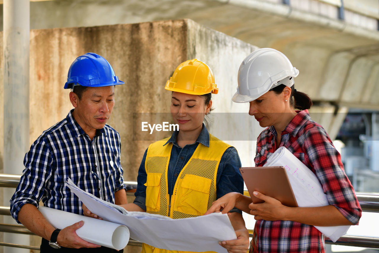 men, occupation, communication, helmet, males, hardhat, holding, working, cooperation, hat, teamwork, standing, real people, headwear, group of people, adult, digital tablet, technology, coworker, young adult, wireless technology, mature adult, mature men, design professional