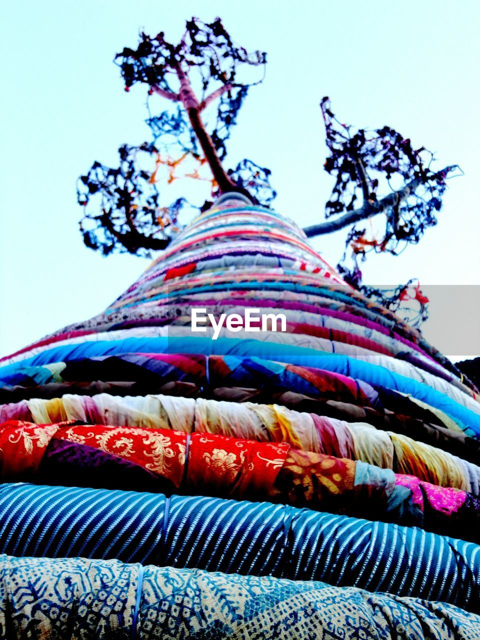 Low Angle View Of Multi Colored Ropes Tied To Tree Against Sky