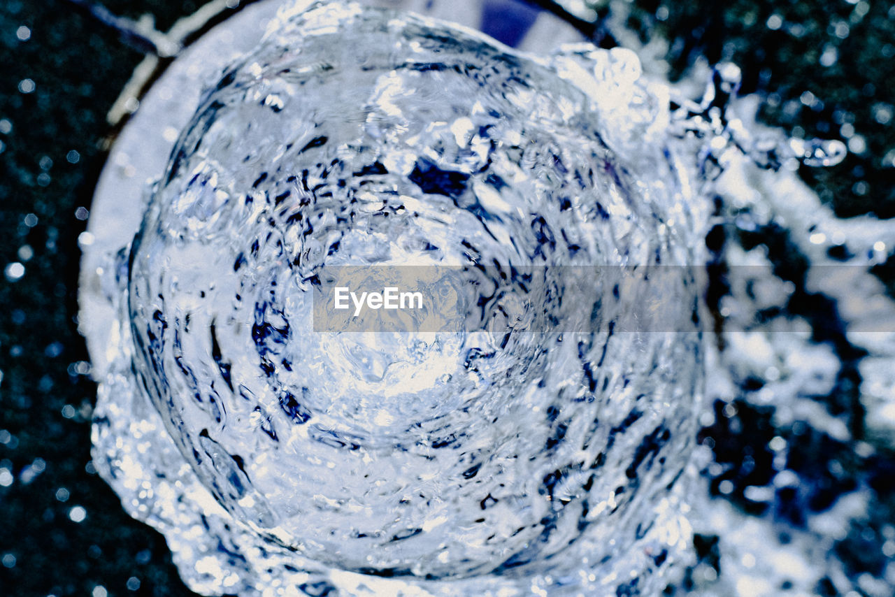 nature, water, close-up, no people, outdoors, cold temperature, purity, blue, bubble, day, planet earth, single object, sphere, freshness, motion, household equipment, frozen, flowing water, clean