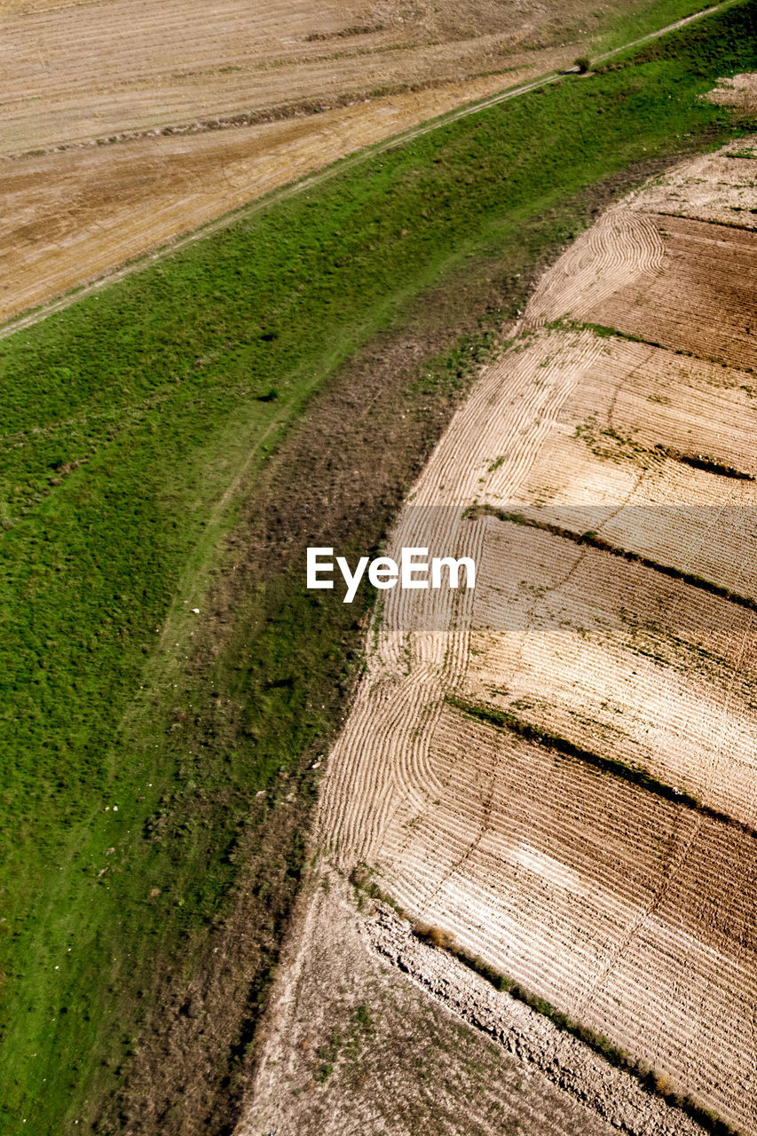 High Angle View Of Footpath Amidst Field