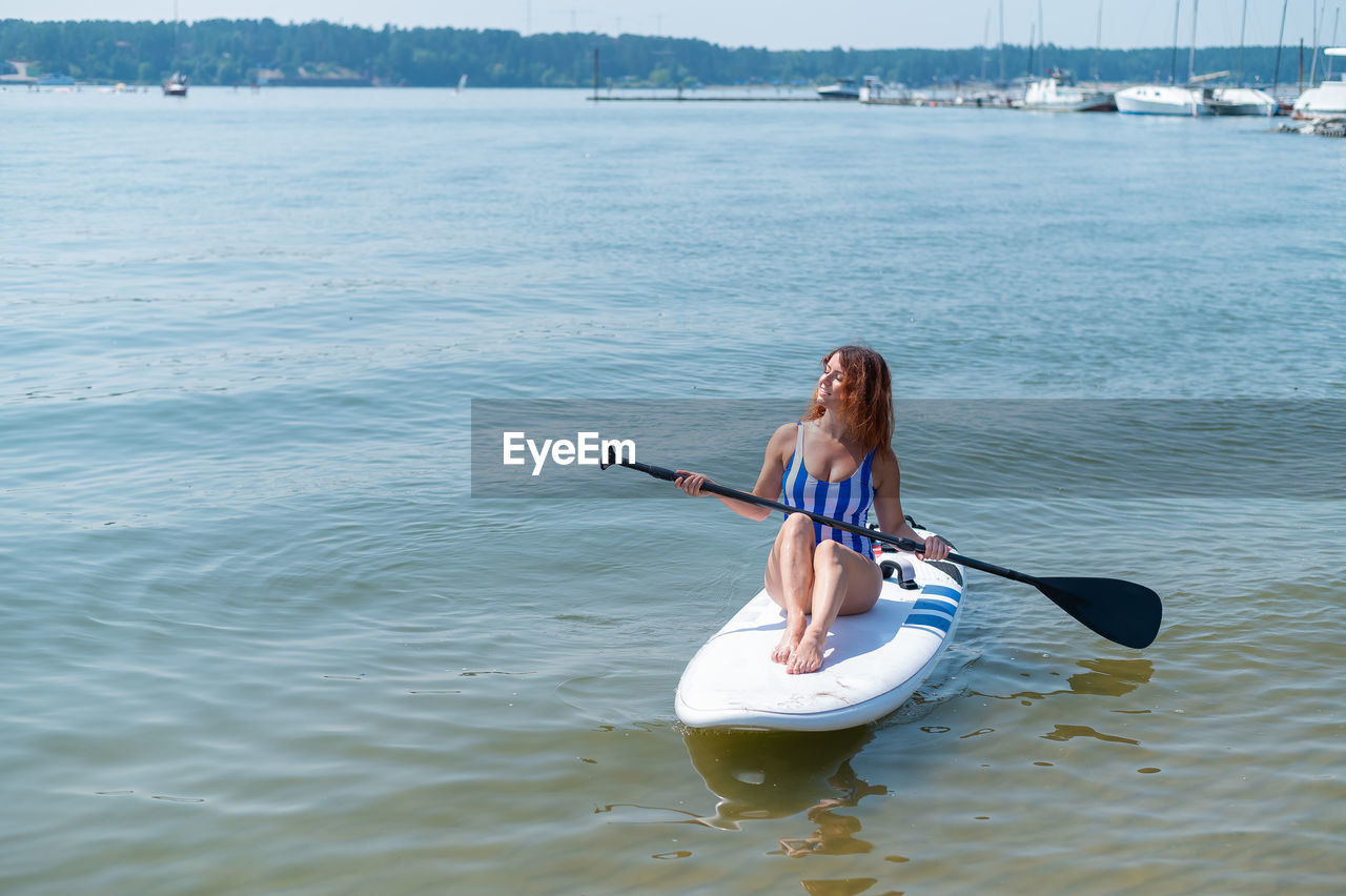 Woman sitting in sea