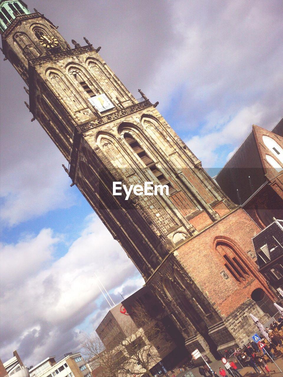 Tilt Image Of Martinitoren Church Against Cloudy Sky