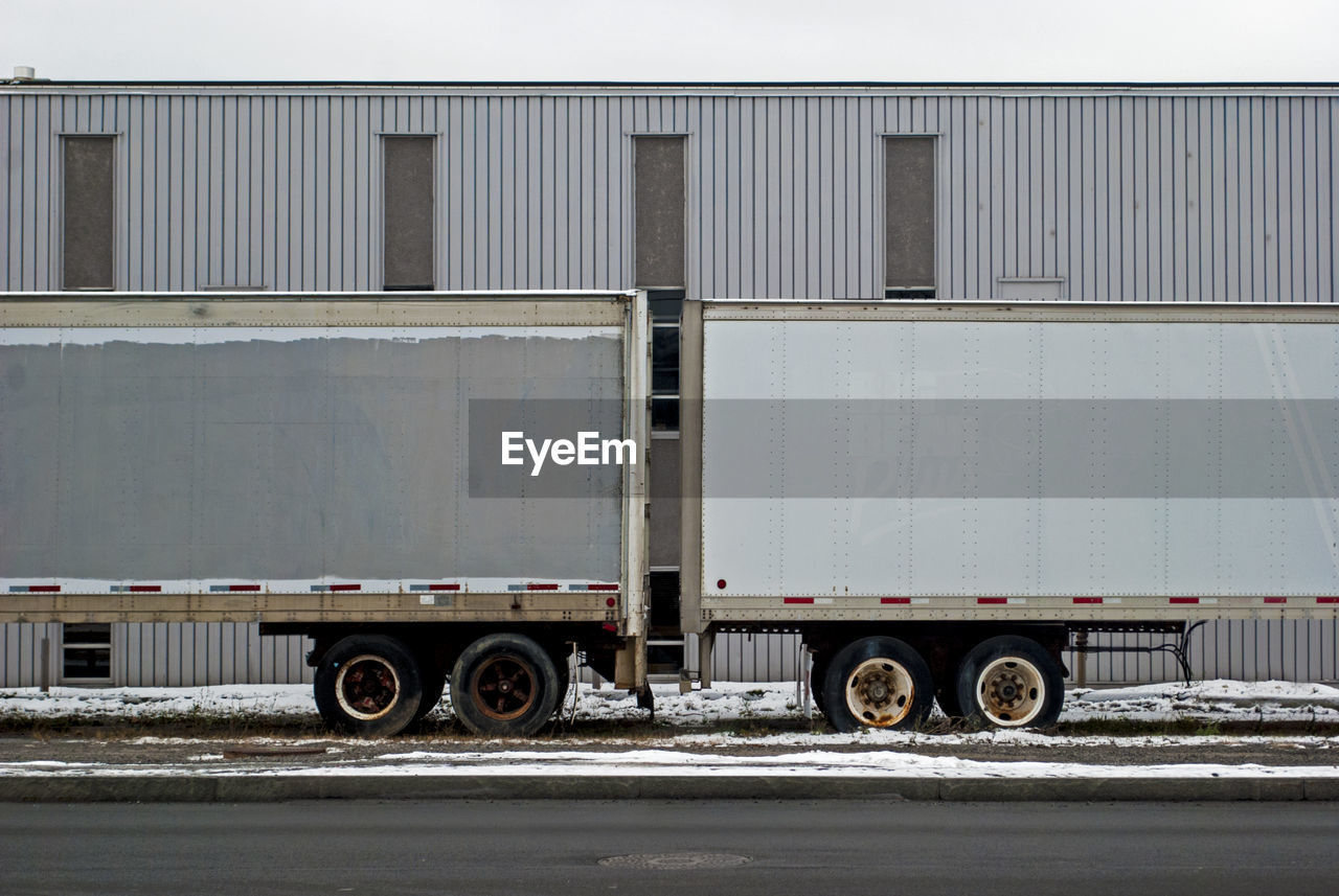 Semi-truck parked on street during winter