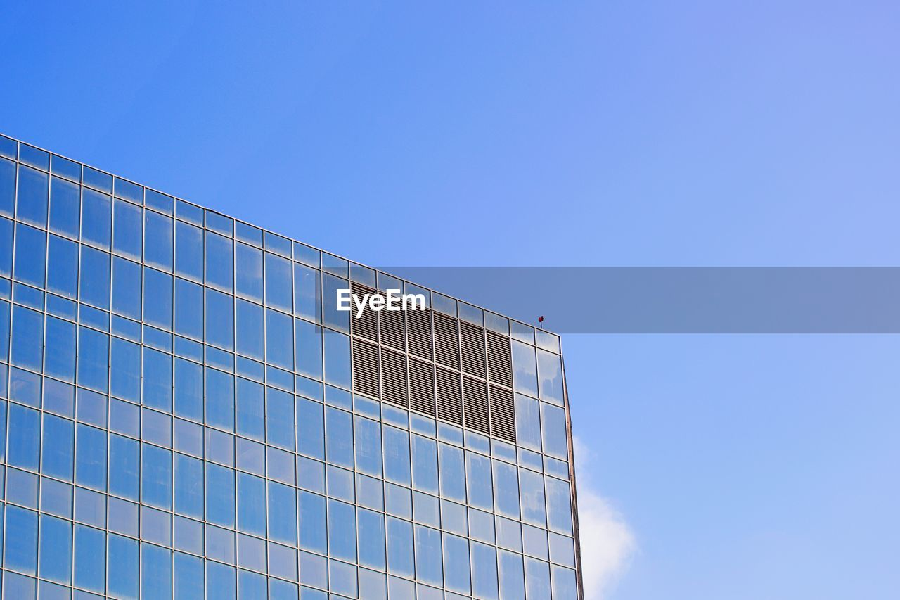 blue, sky, low angle view, clear sky, built structure, day, architecture, copy space, nature, no people, building exterior, sunlight, office, outdoors, modern, office building exterior, fuel and power generation, building, reflection, pattern