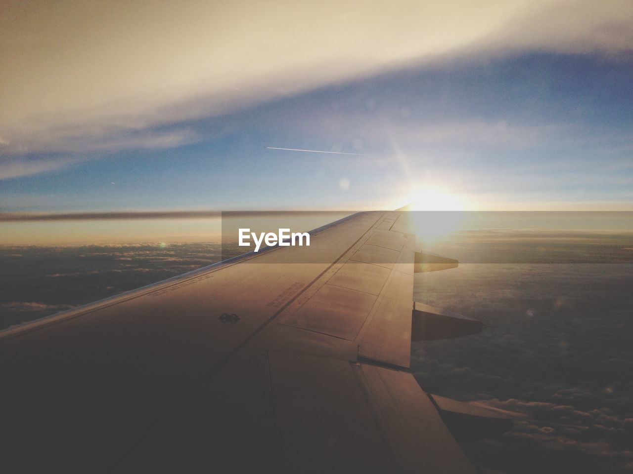 airplane, airplane wing, journey, transportation, sunset, aerial view, flying, travel, air vehicle, sky, aircraft wing, sun, no people, scenics, mode of transport, cloud - sky, lens flare, mid-air, sunlight, nature, beauty in nature, tranquil scene, outdoors, landscape, vehicle part, day, close-up