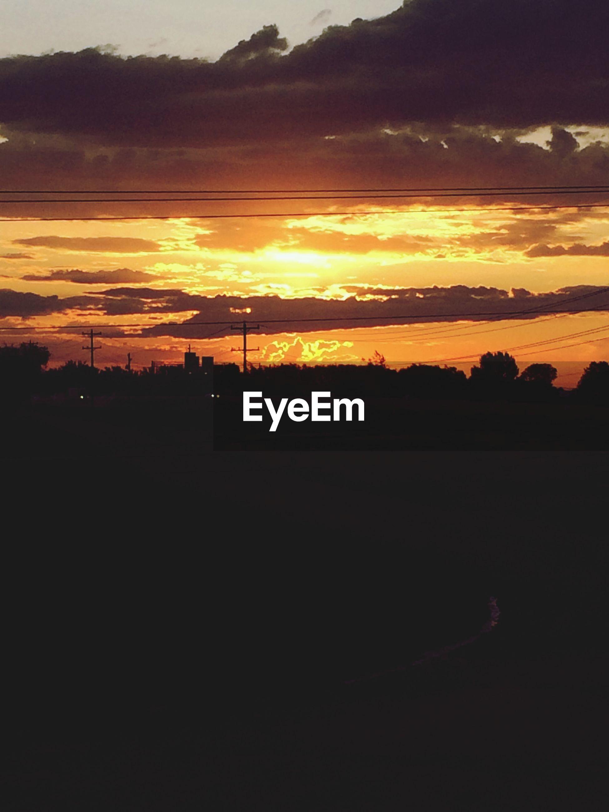 sunset, silhouette, sky, scenics, orange color, tranquil scene, beauty in nature, tranquility, cloud - sky, idyllic, nature, dark, sun, cloud, dramatic sky, tree, landscape, water, outdoors, no people