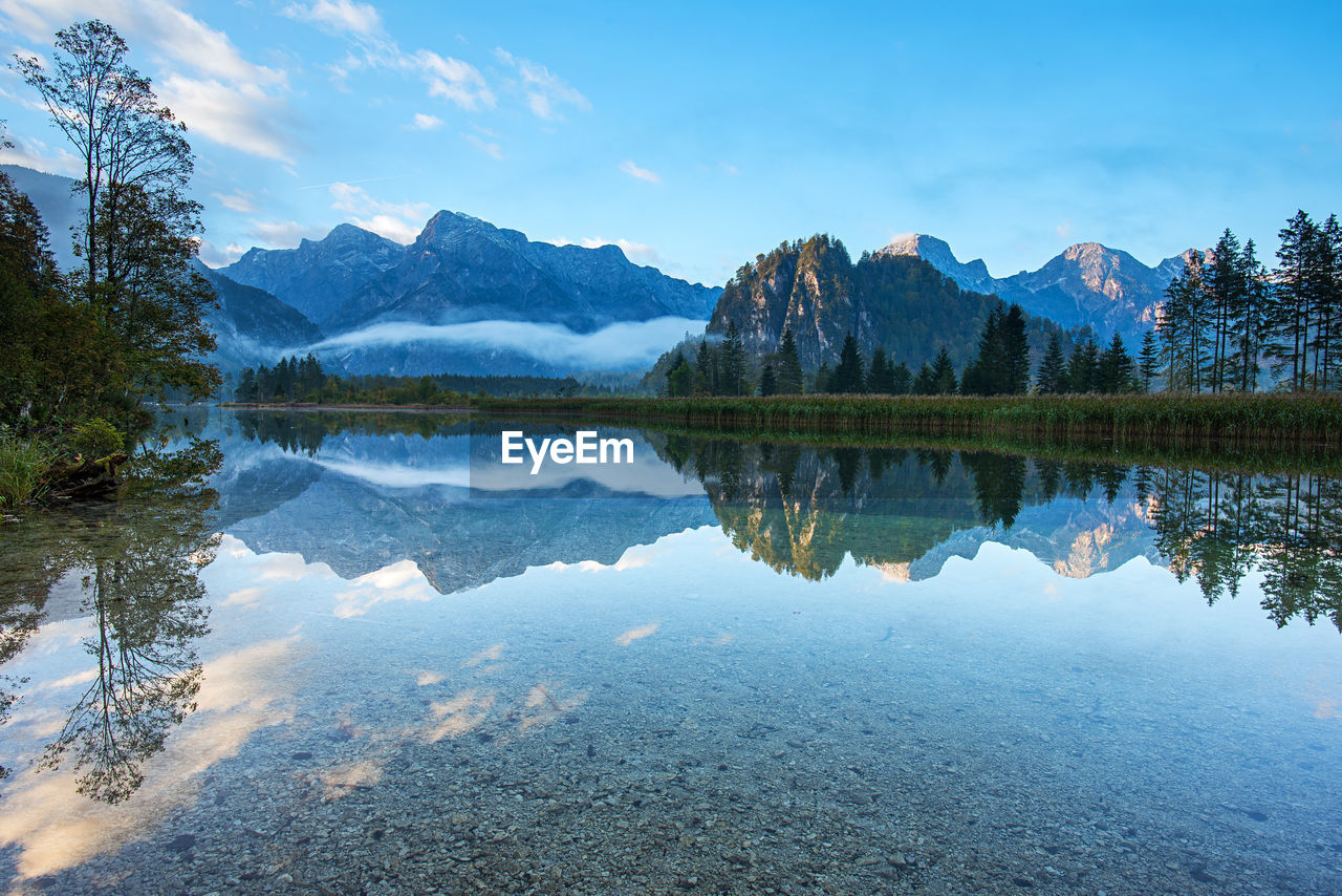 reflection, water, mountain, tranquility, tranquil scene, lake, beauty in nature, scenics - nature, sky, tree, mountain range, non-urban scene, plant, nature, waterfront, idyllic, day, no people, symmetry, outdoors, reflection lake