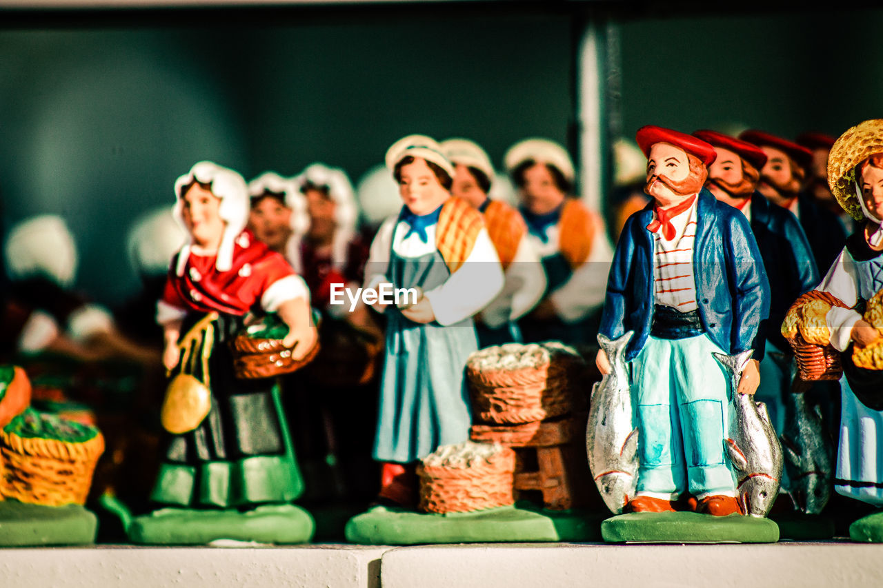 Close-up of figurines for sale at shop during christmas