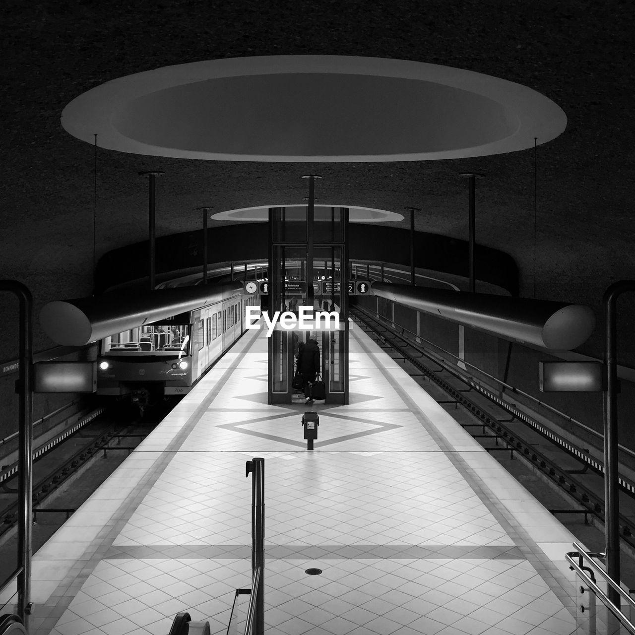 transportation, illuminated, railroad station platform, night, indoors, real people