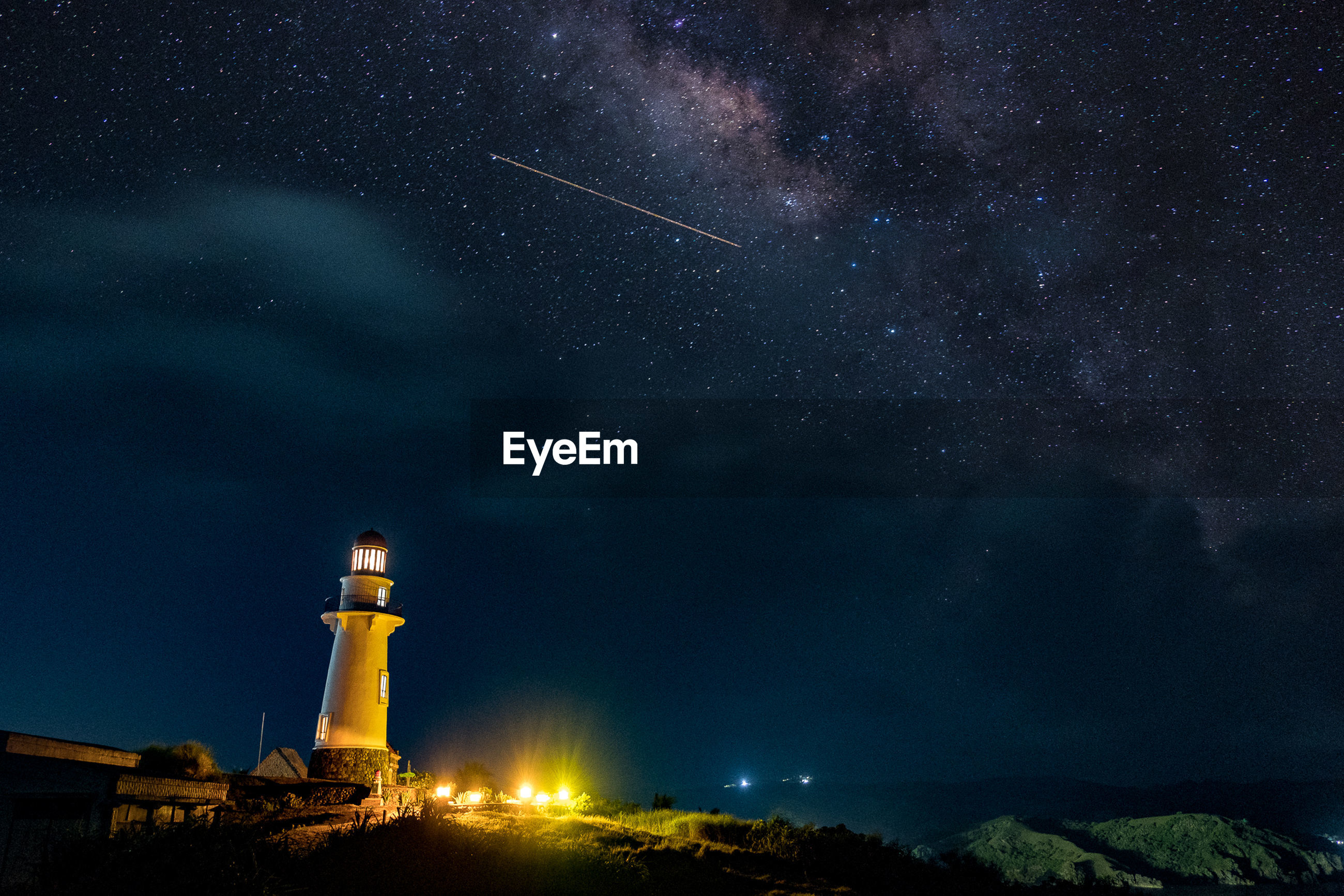 Low angle view of lighthouse against star field