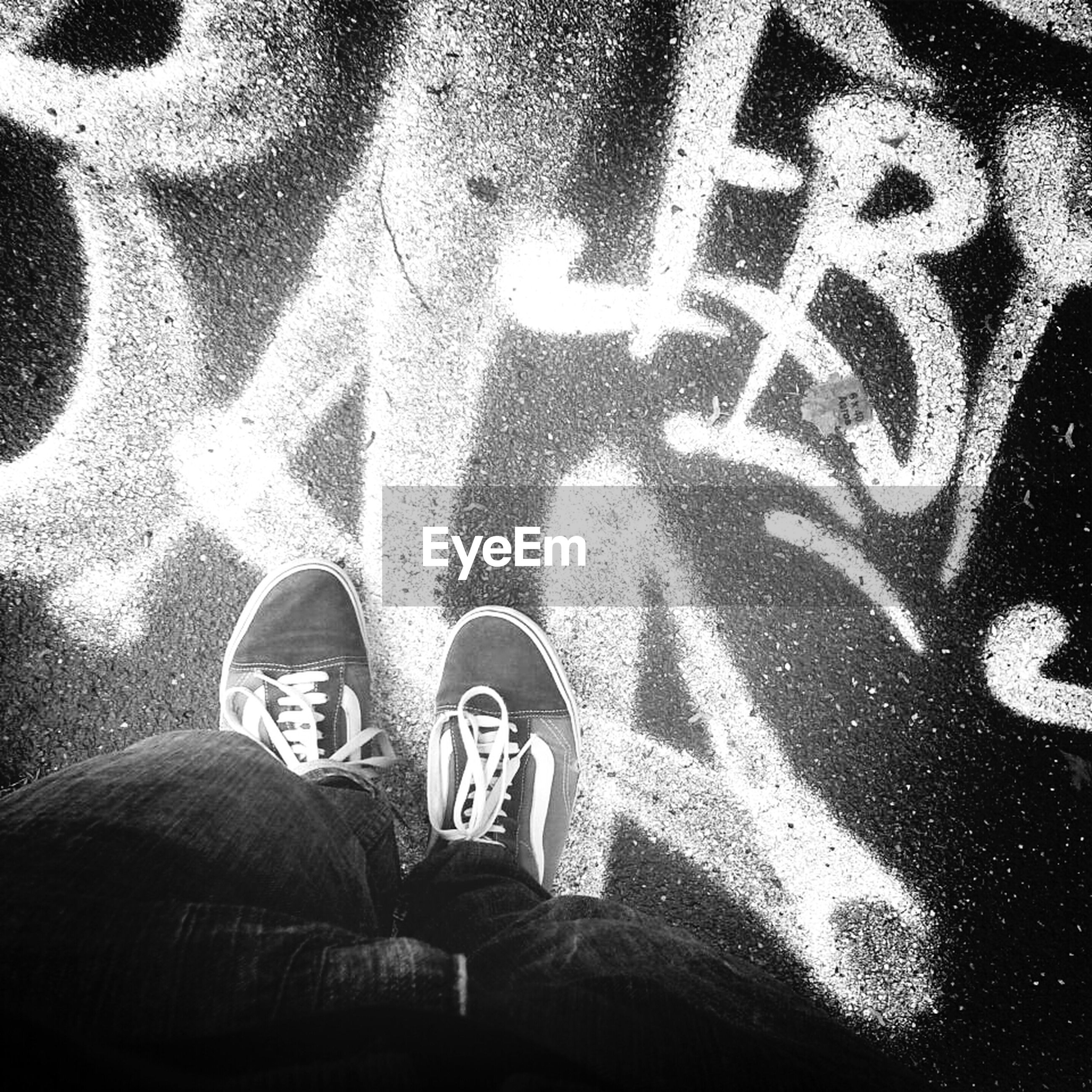 men, low section, lifestyles, shoe, high angle view, person, leisure activity, standing, personal perspective, unrecognizable person, text, western script, creativity, human representation, pattern, close-up, human foot