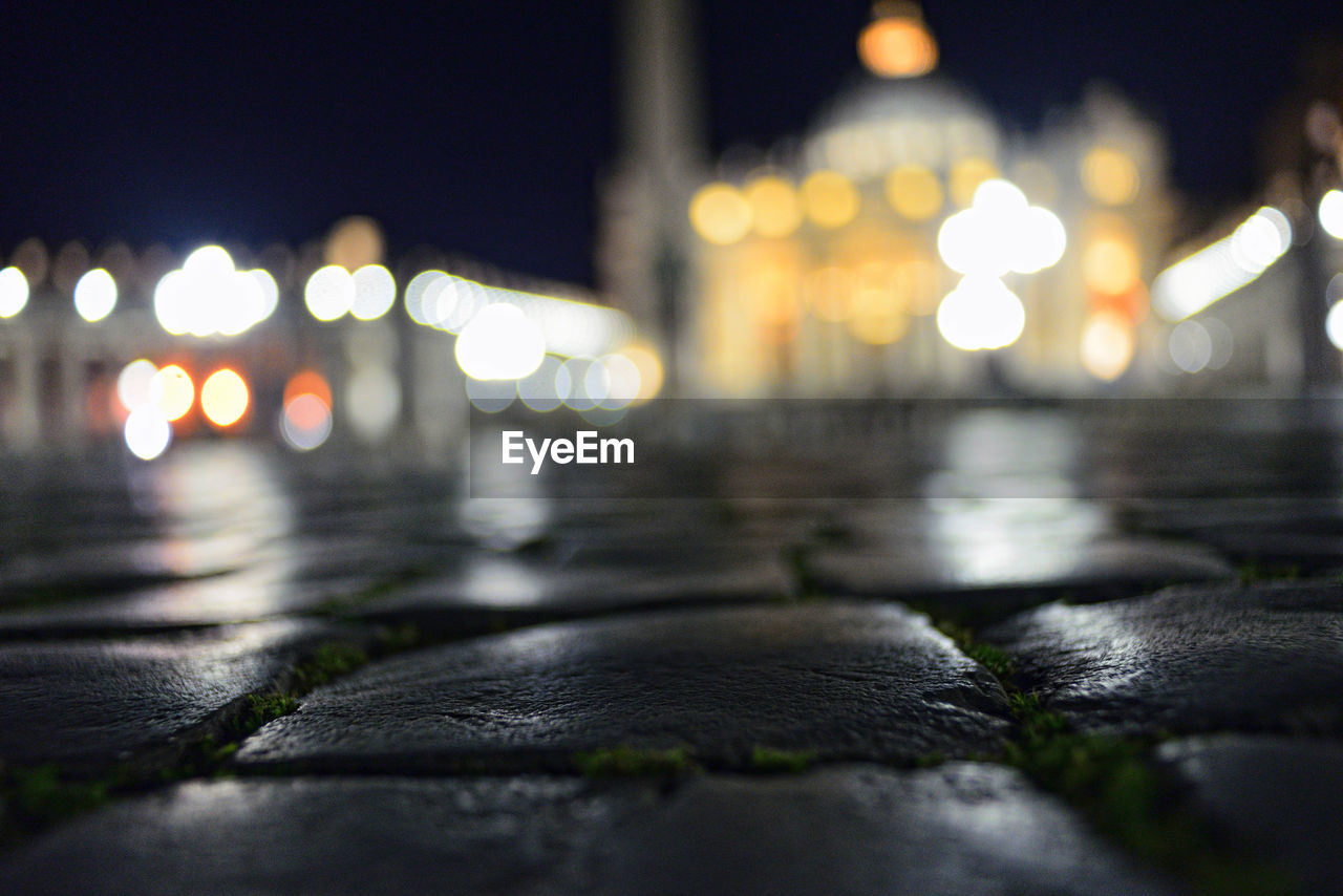 night, illuminated, surface level, selective focus, no people, close-up, outdoors, nature, water, city