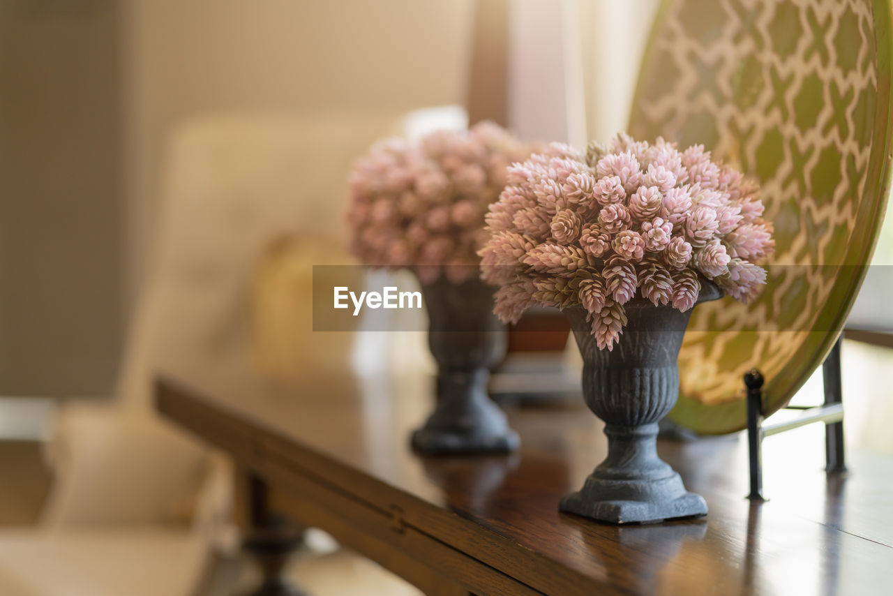 indoors, flower, flowering plant, table, no people, plant, focus on foreground, close-up, vase, still life, home interior, selective focus, seat, freshness, wood - material, nature, furniture, decoration, chair, arrangement, flower head, flower arrangement