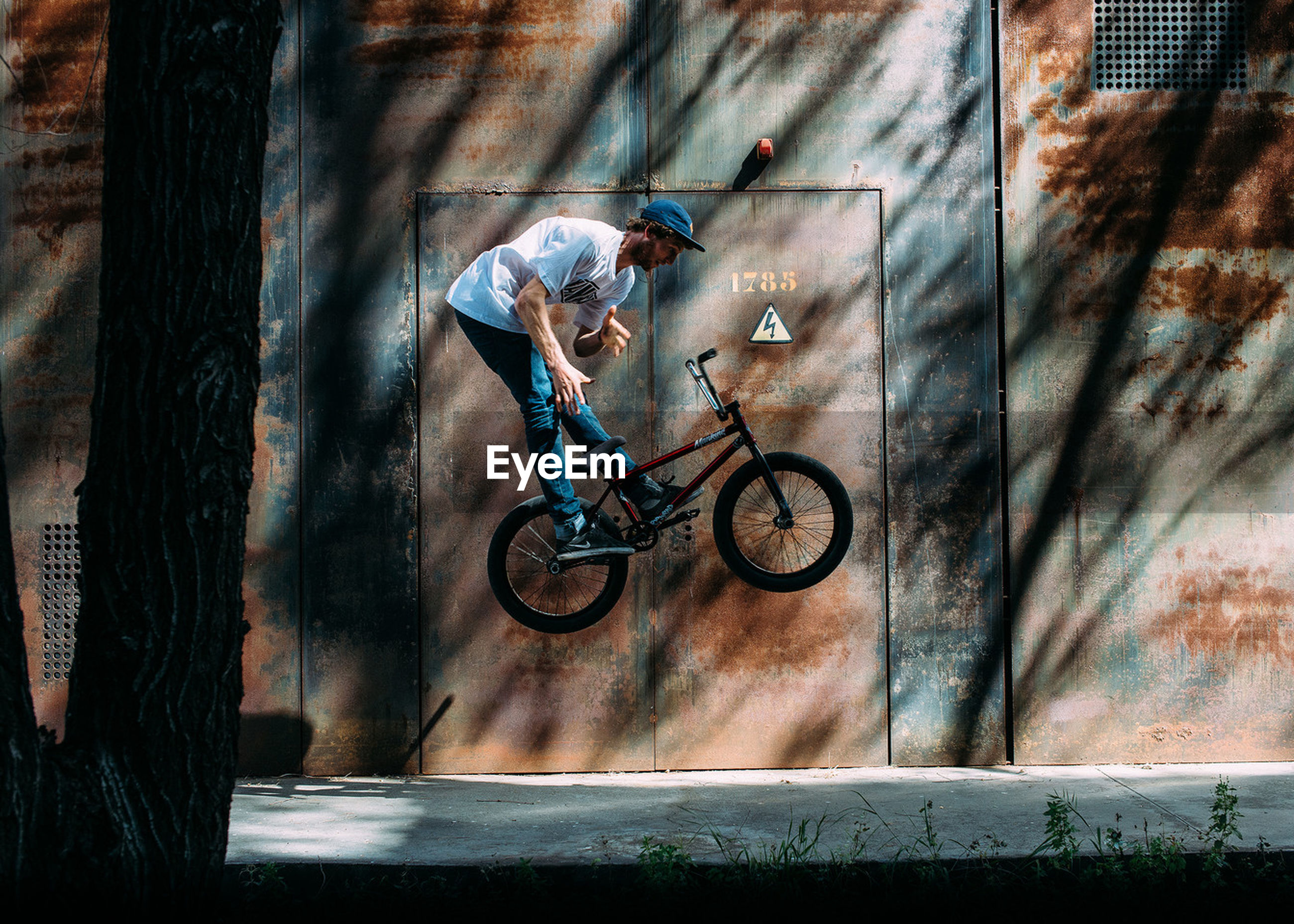indoors, bicycle, wall - building feature, wood - material, still life, table, hanging, full length, day, art and craft, wall, no people, high angle view, door, art, variation, wooden, creativity, skill