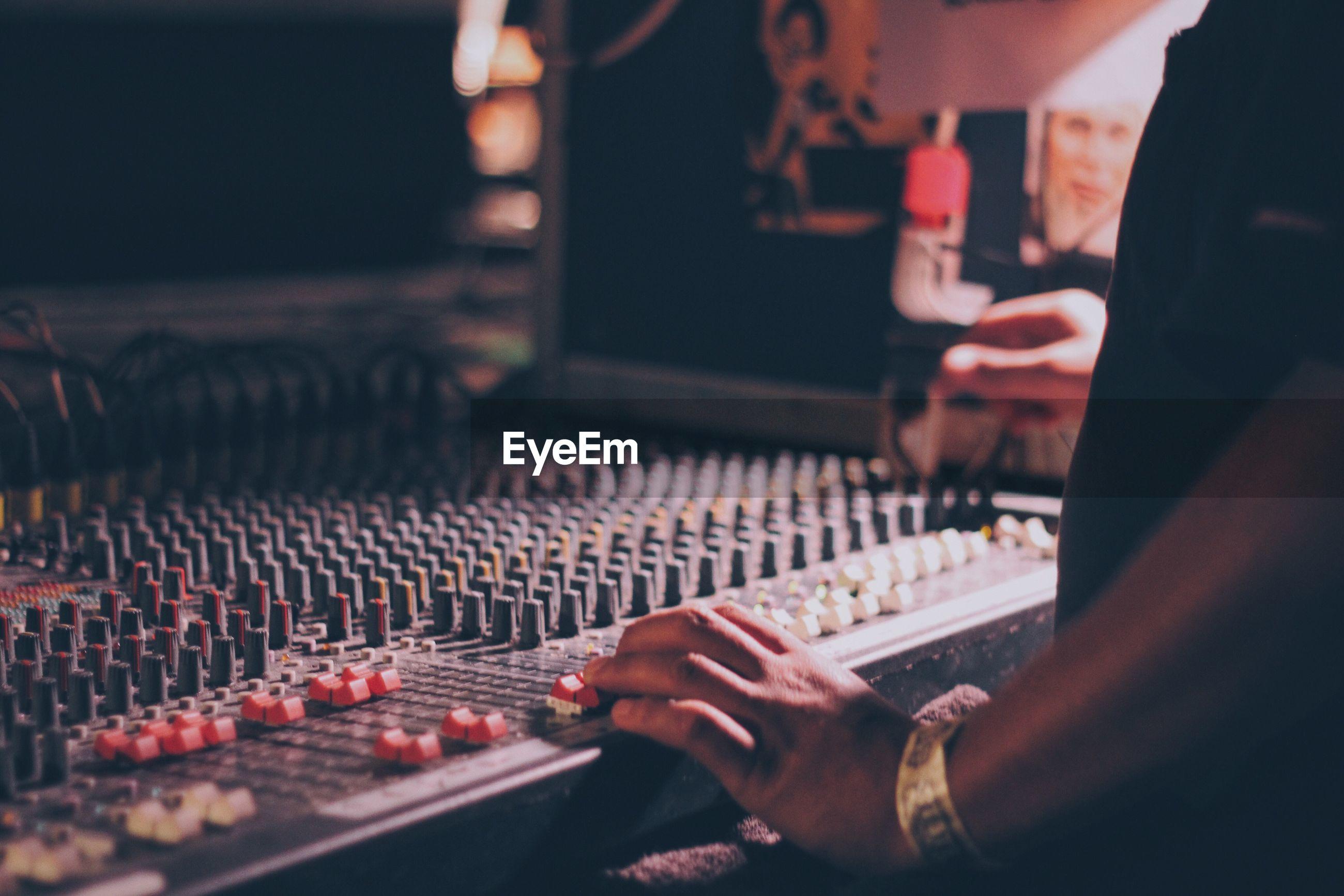 Close-up of hand using sound mixer