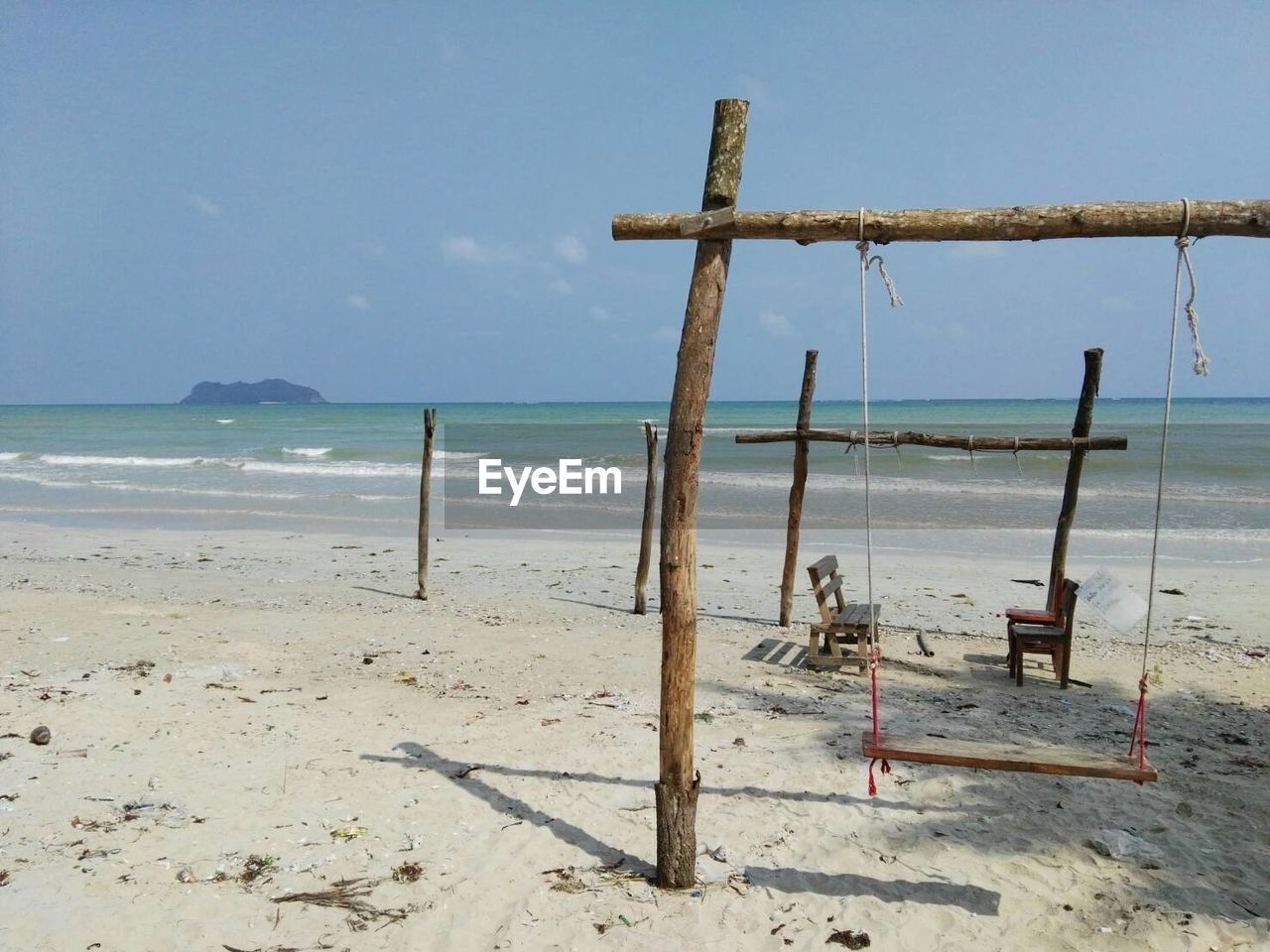 View Of Swing On Beach Against Sky