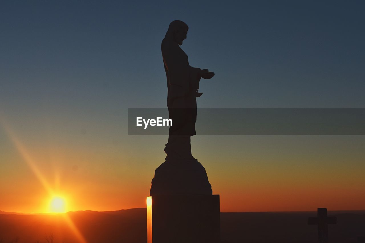 sunset, sky, silhouette, sculpture, statue, sun, human representation, orange color, nature, art and craft, representation, sunlight, beauty in nature, male likeness, copy space, creativity, no people, scenics - nature, clear sky, water