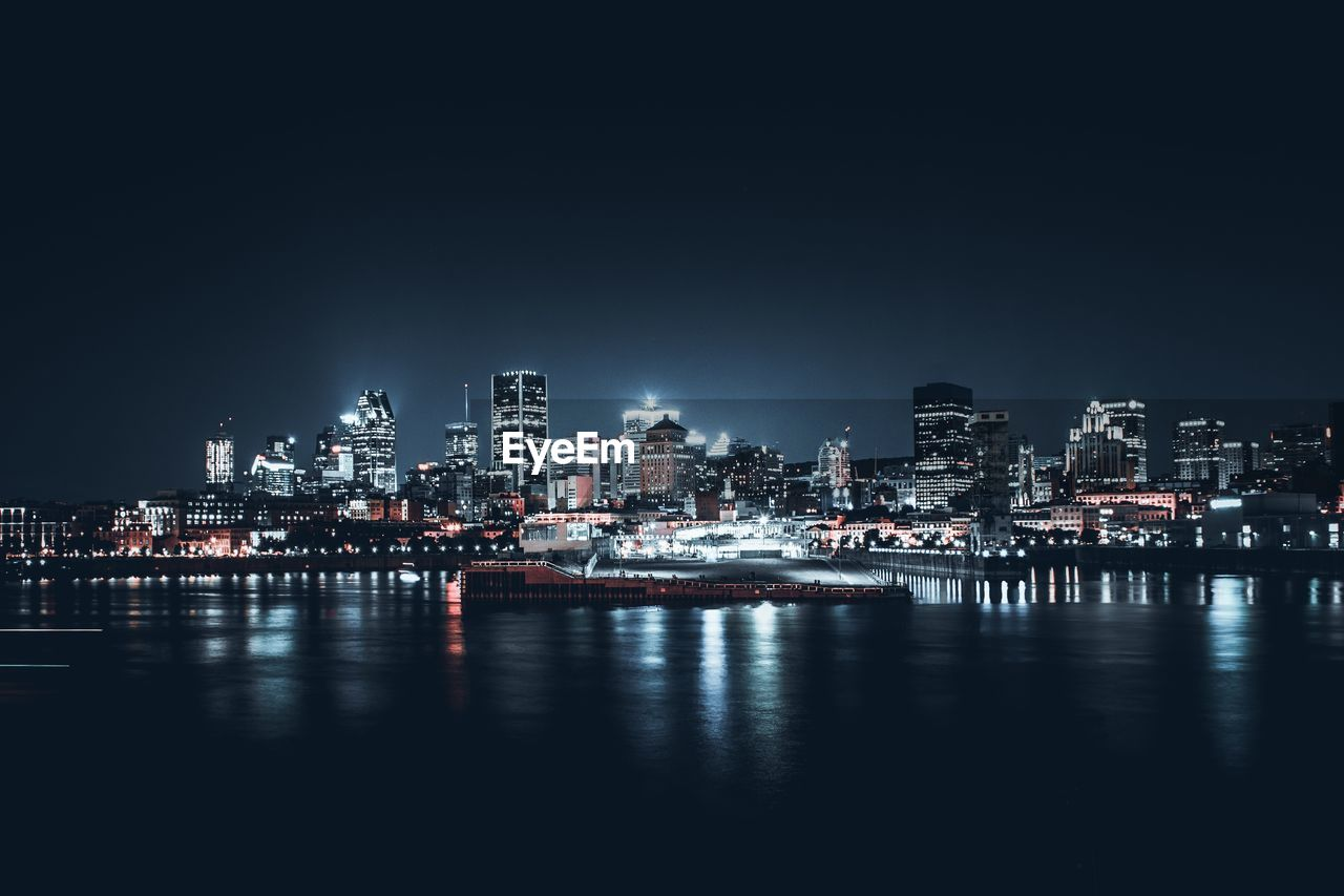 night, water, illuminated, architecture, building exterior, waterfront, sky, built structure, city, reflection, no people, building, transportation, nautical vessel, sea, nature, copy space, cityscape, outdoors, skyscraper, office building exterior, port