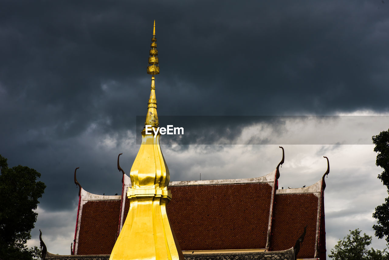 cloud - sky, sky, architecture, built structure, building, building exterior, religion, belief, nature, spirituality, no people, tower, place of worship, yellow, overcast, travel destinations, storm, outdoors, low angle view, spire