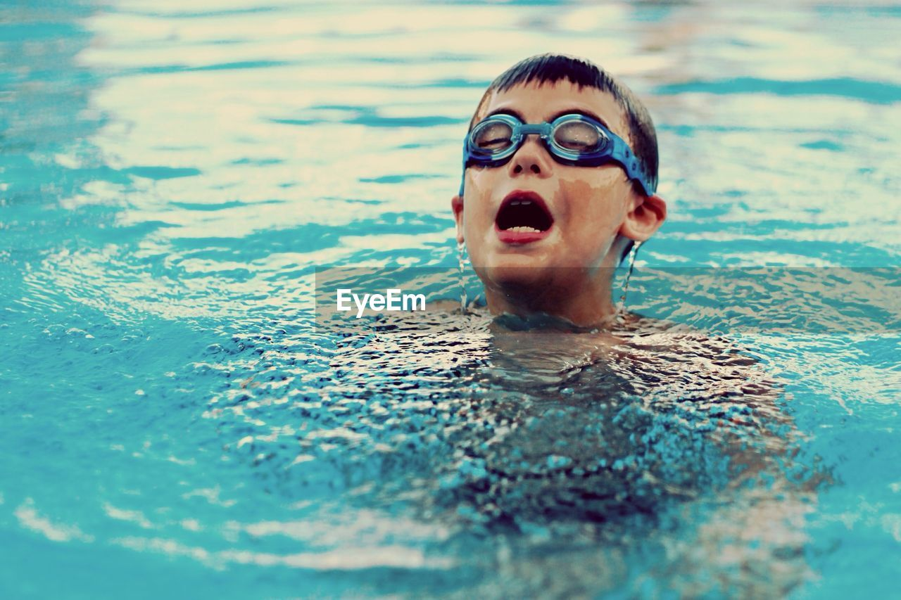 Close-Up Of Boy In Swimming Pool
